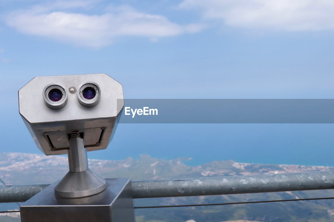 coin operated, binoculars, coin-operated binoculars, sky, cloud - sky, nature, day, scenics - nature, no people, railing, focus on foreground, beauty in nature, outdoors, surveillance, close-up, security, observation point, metal, blue, water, astronomy, hand-held telescope