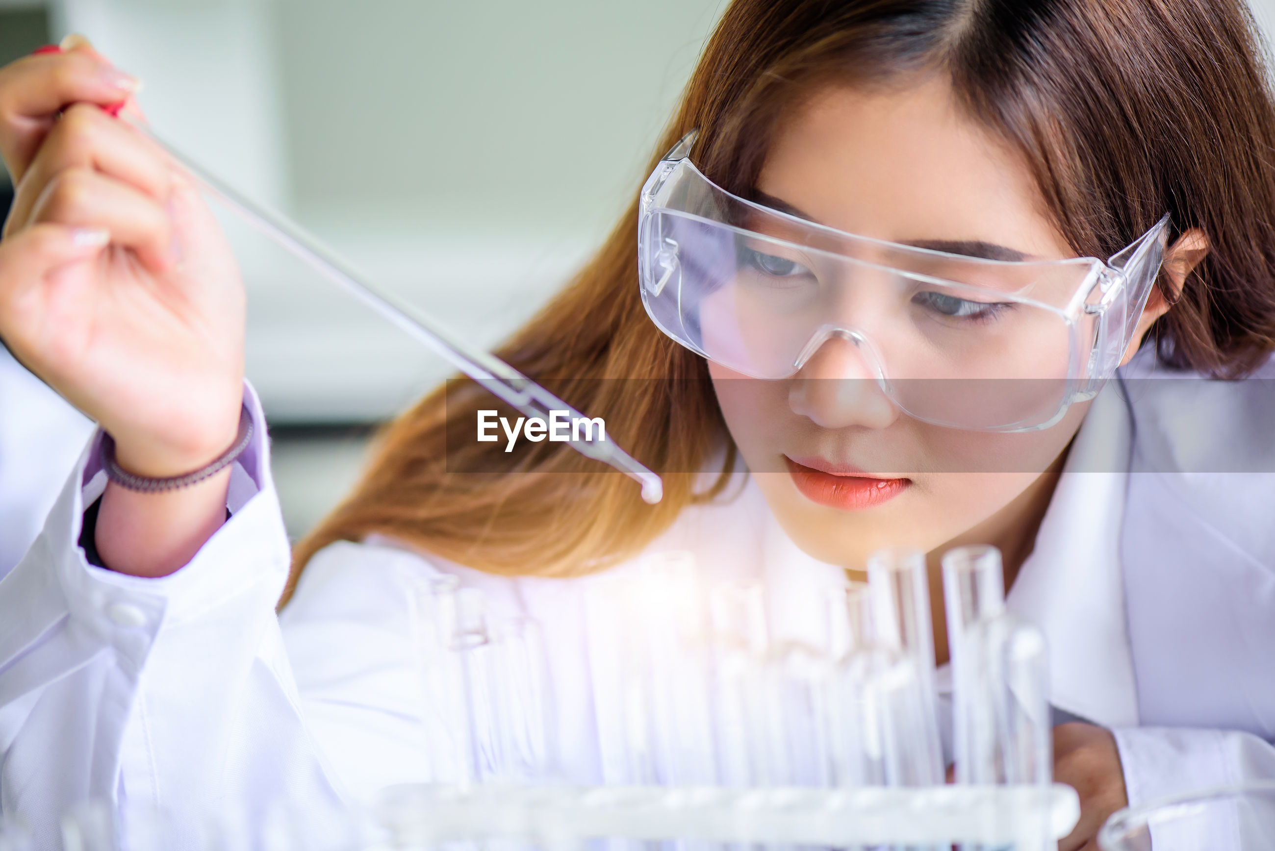 Woman experimenting in laboratory
