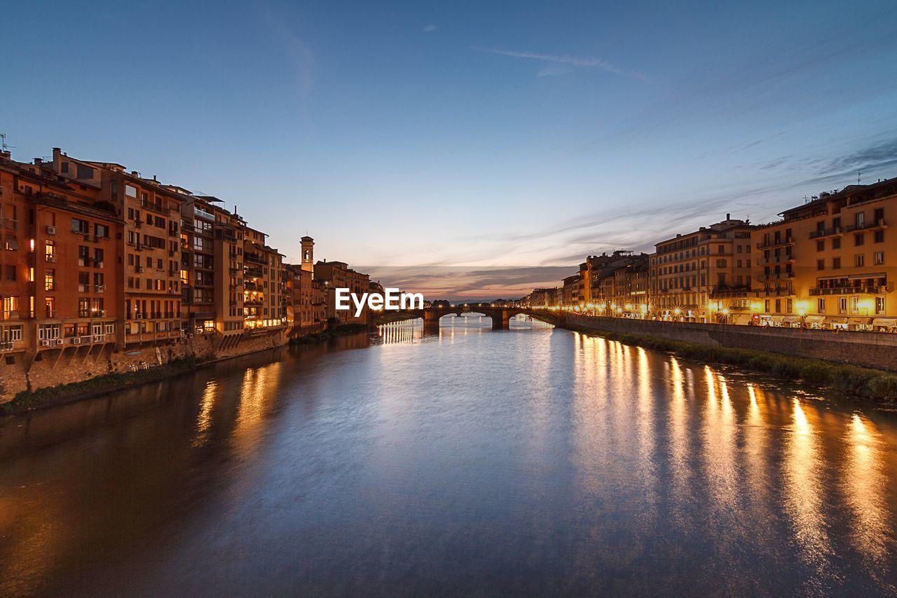 Ponte Vecchio Bridge Over Arno River At Dusk
