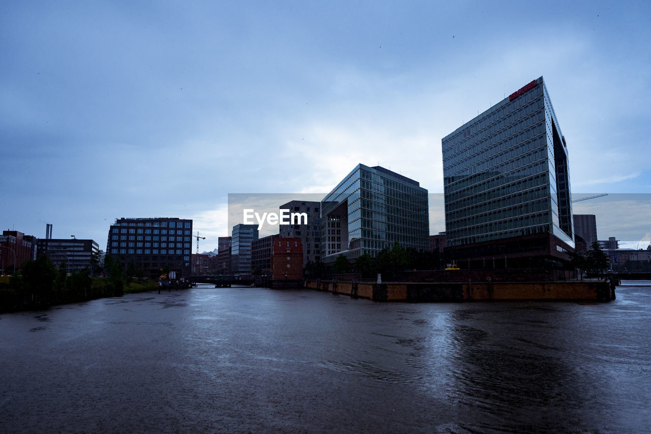architecture, sky, building exterior, built structure, city, water, cloud - sky, building, nature, waterfront, no people, office building exterior, modern, river, office, dusk, tall - high, outdoors, skyscraper, cityscape