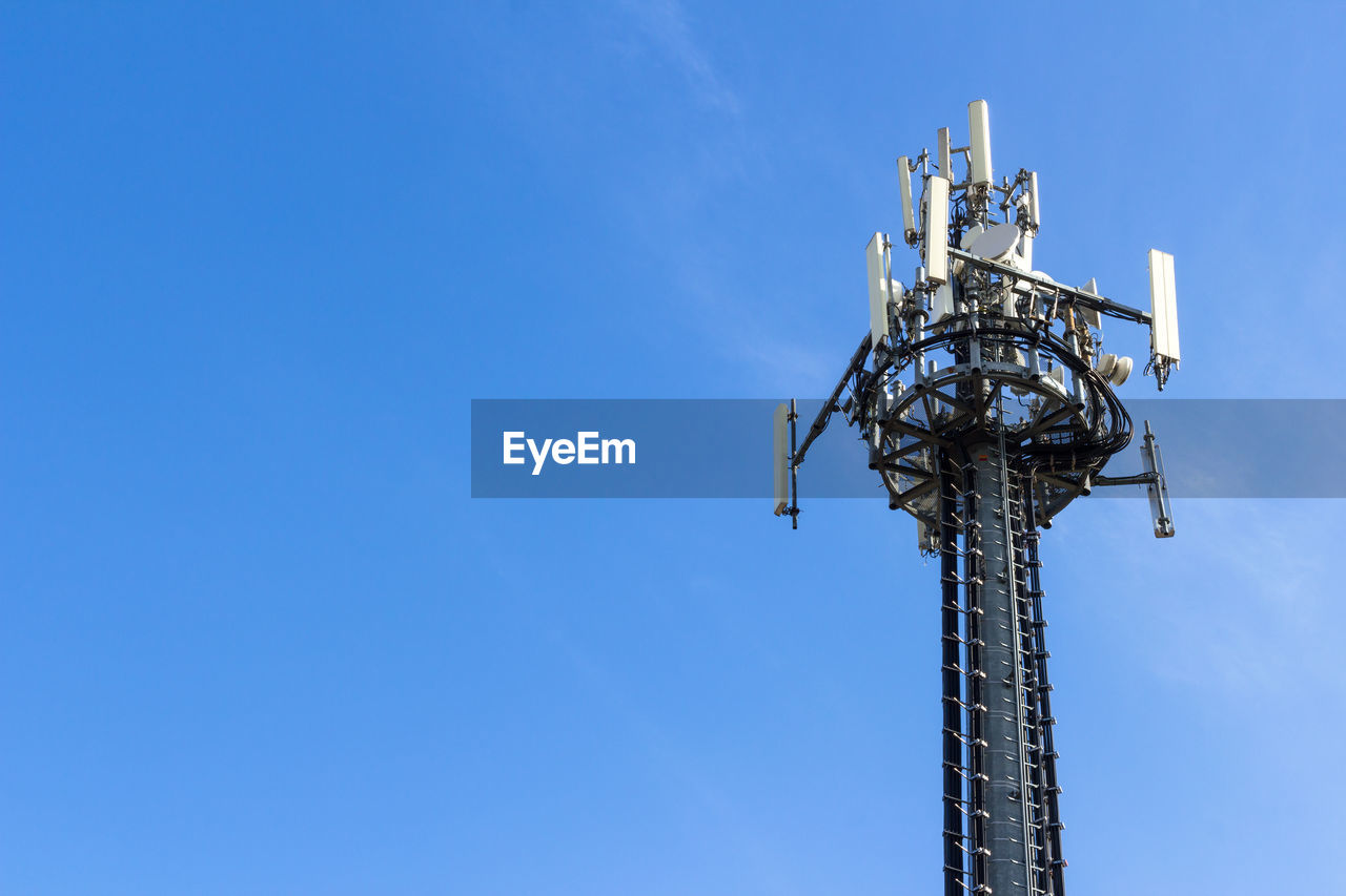 sky, low angle view, blue, technology, copy space, tower, no people, communication, antenna - aerial, nature, tall - high, architecture, connection, built structure, clear sky, day, outdoors, telecommunications equipment, wireless technology, global communications, electrical equipment