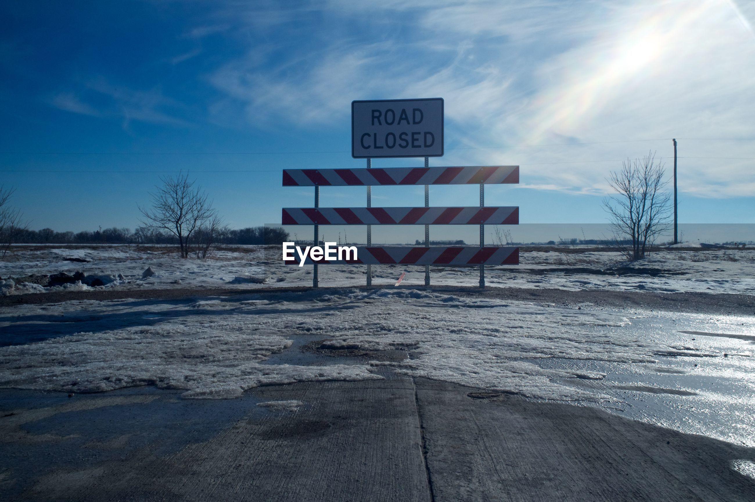 Warning sign on snow