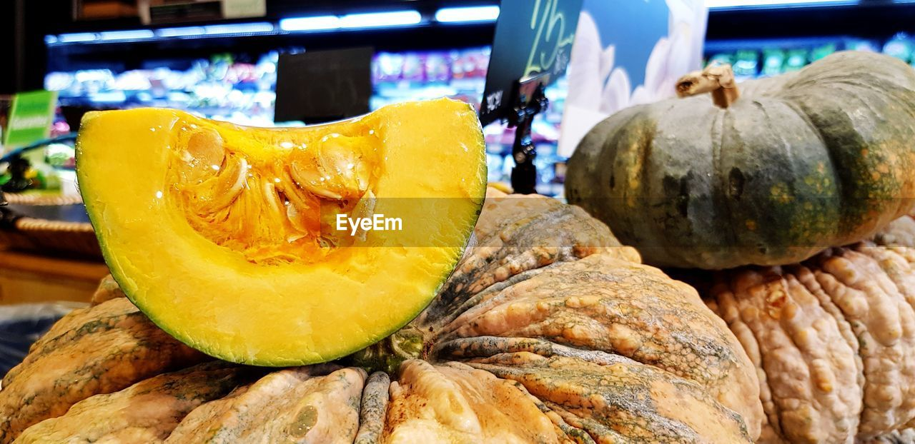 food and drink, food, freshness, wellbeing, healthy eating, still life, pumpkin, close-up, retail, focus on foreground, market, no people, for sale, indoors, fruit, vegetable, choice, business, market stall, orange color, retail display, ripe