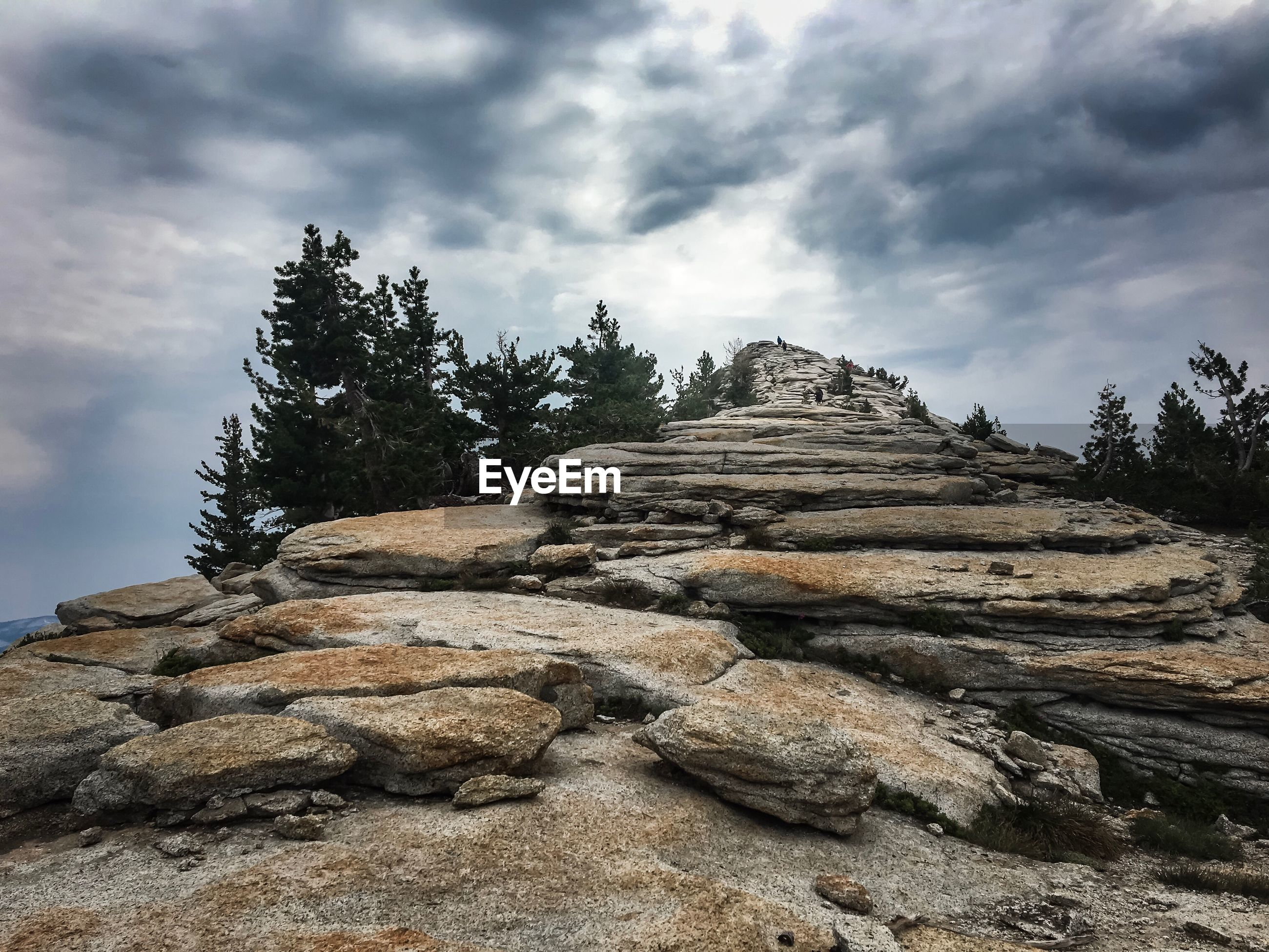 LOW ANGLE VIEW OF STACK OF ROCKS AGAINST SKY