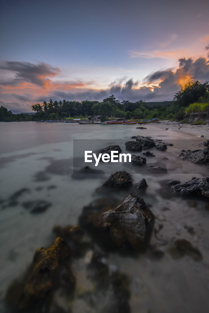 sky, sunset, water, cloud - sky, beauty in nature, scenics - nature, sea, tranquility, tranquil scene, no people, nature, orange color, land, beach, solid, idyllic, rock - object, rock, non-urban scene, outdoors, surface level