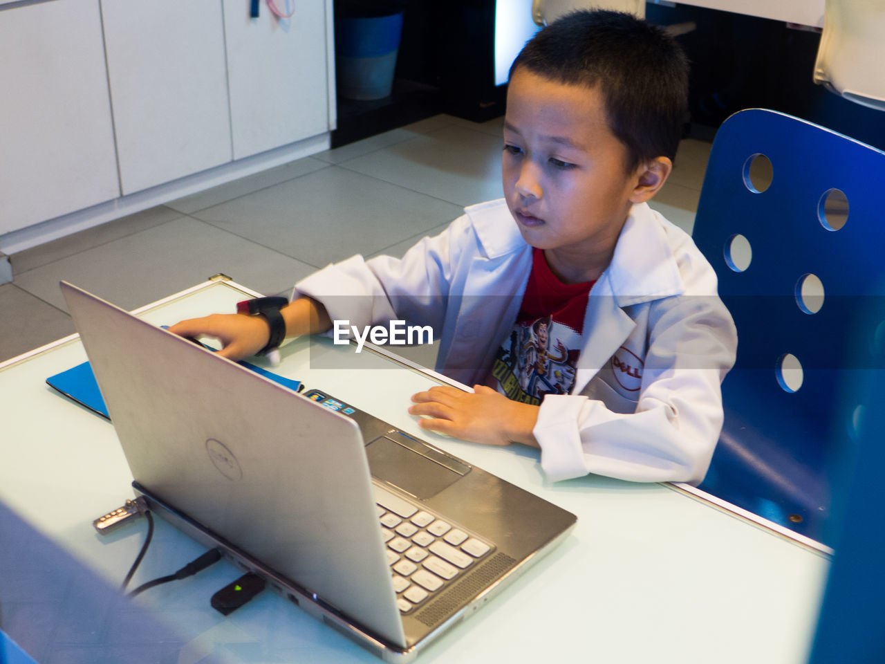 boys, childhood, education, learning, technology, real people, laptop, indoors, wireless technology, sitting, elementary age, desk, one person, classroom, concentration, using laptop, student, school uniform, day, people