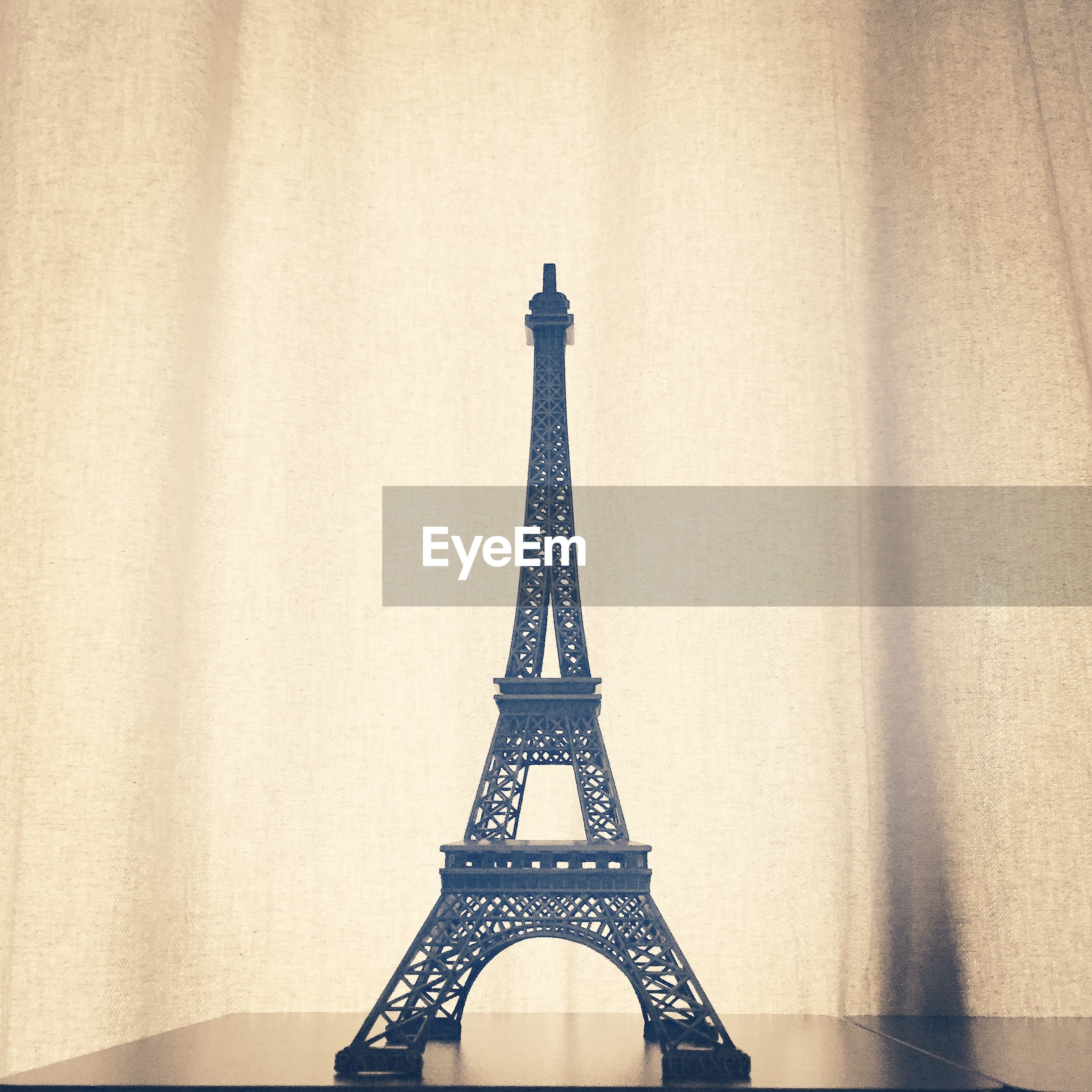 architecture, built structure, eiffel tower, metal, tower, low angle view, international landmark, famous place, tall - high, travel destinations, culture, clear sky, capital cities, metallic, building exterior, sky, tourism, travel, architectural feature, no people