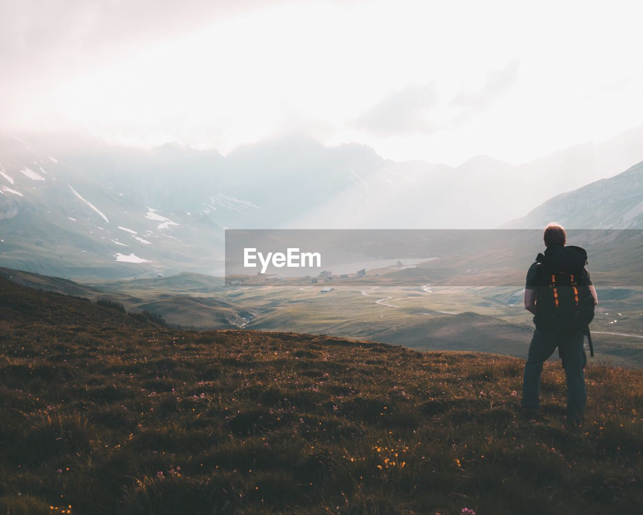 Rear view of hiker looking at mountains