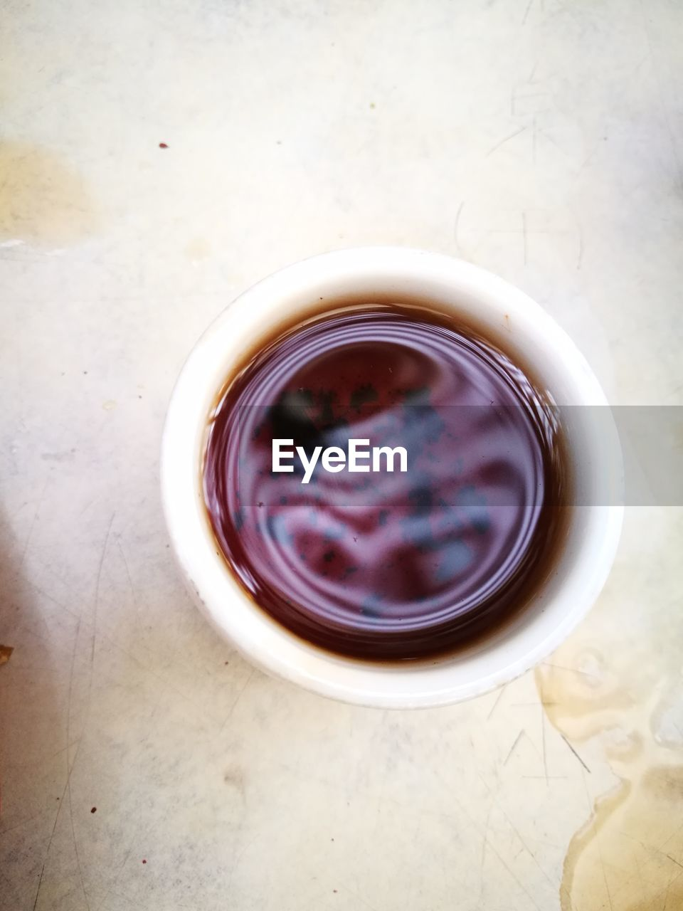 directly above, indoors, no people, food and drink, refreshment, drink, table, still life, high angle view, cup, food, freshness, container, flooring, close-up, hot drink, geometric shape, circle, glass - material, mug, tea cup