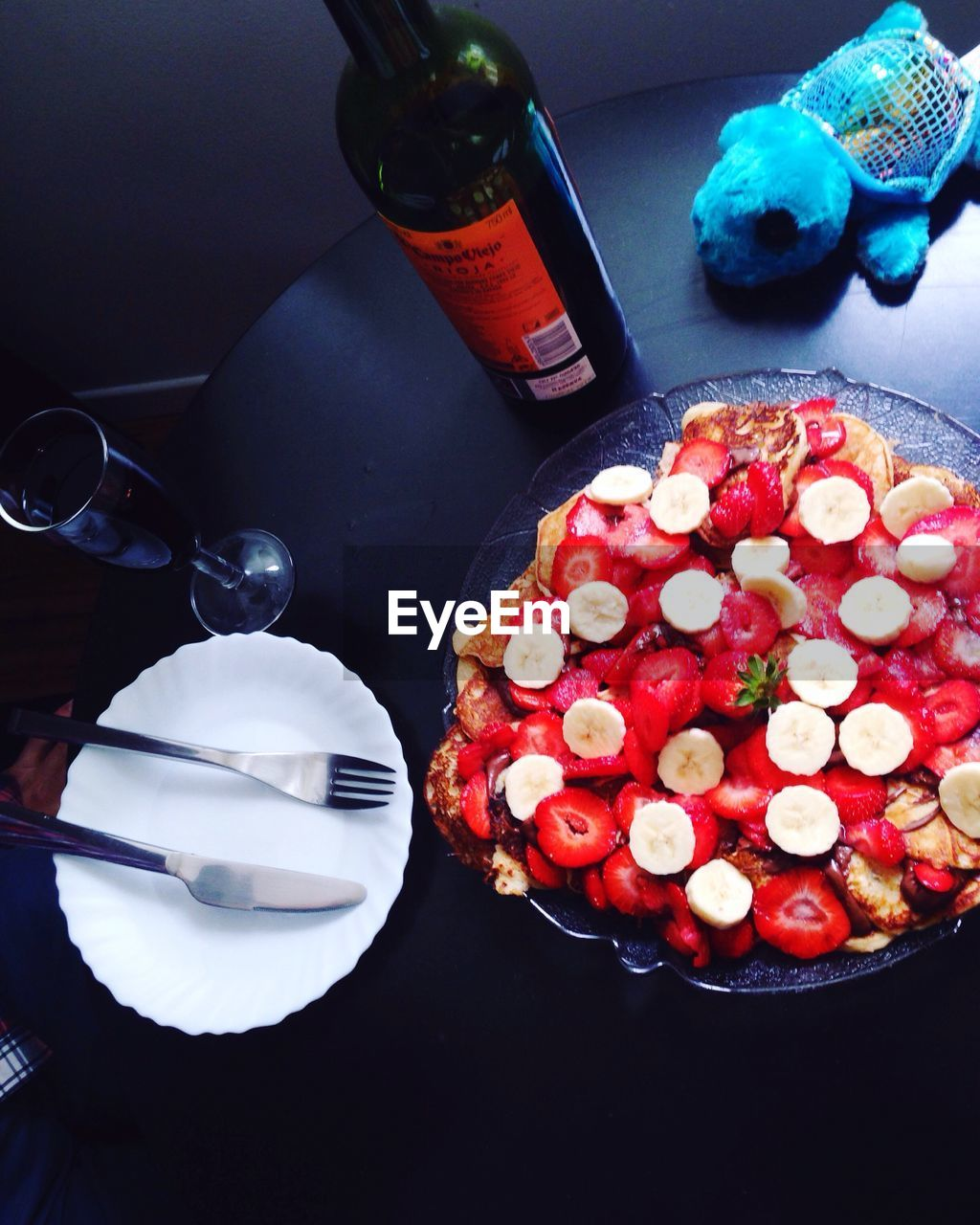 food and drink, table, food, freshness, indulgence, high angle view, sweet food, temptation, plate, no people, bottle, indoors, ready-to-eat, unhealthy eating, directly above, dessert, red, close-up, day
