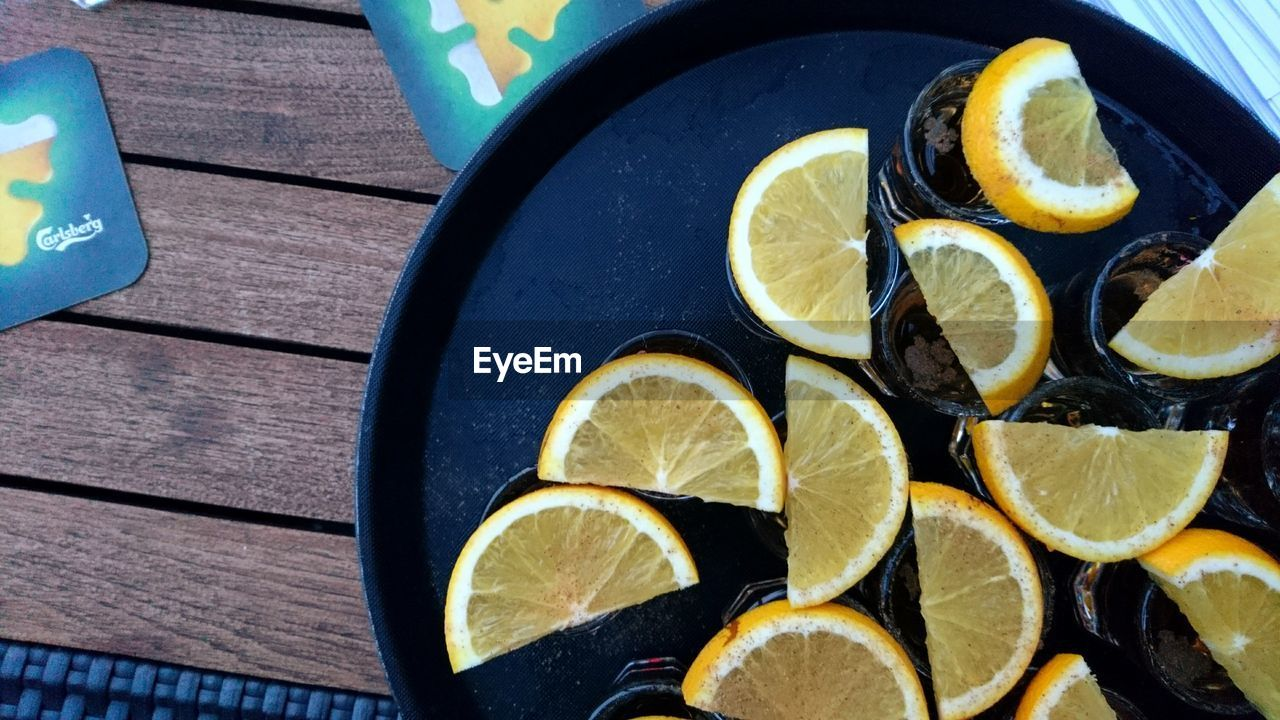 lemon, lime, food and drink, citrus fruit, slice, table, no people, high angle view, freshness, fruit, food, indoors, alcohol, close-up, drink, day, sour taste