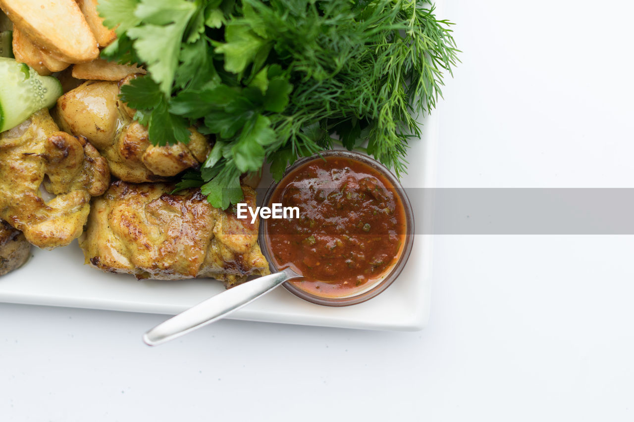 Directly above shot of food served in plate over white background