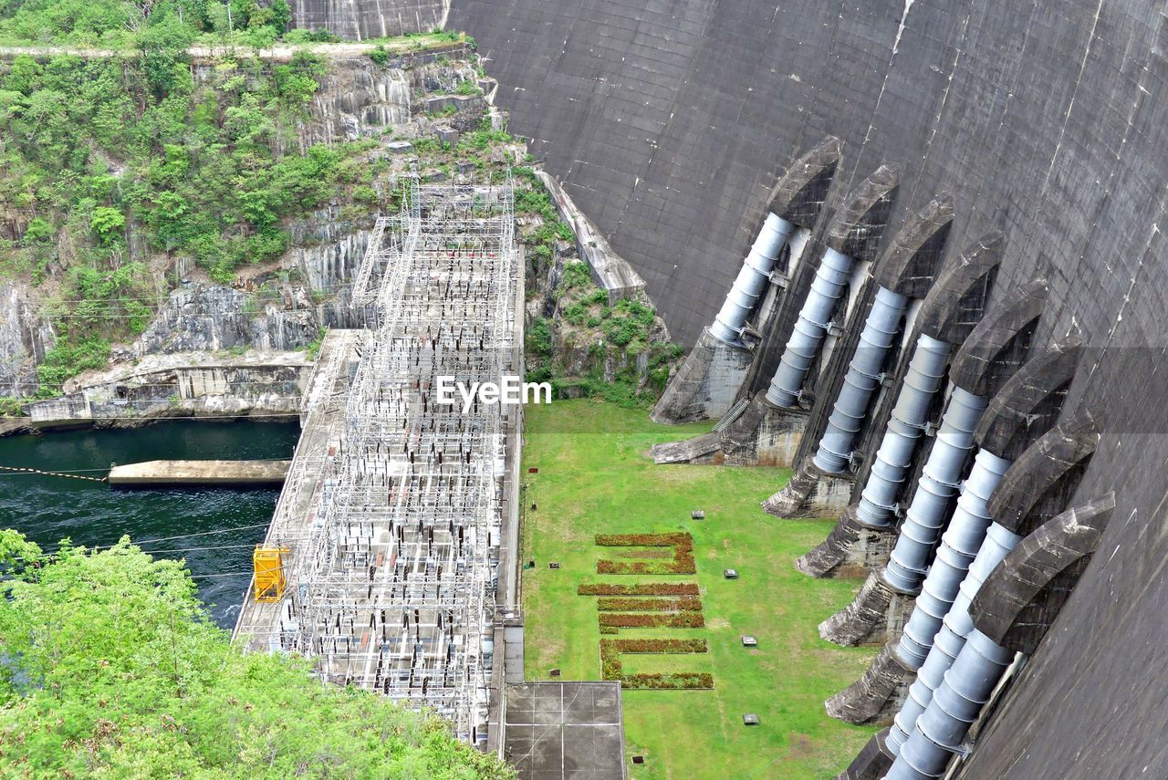 water, day, architecture, nature, no people, plant, built structure, connection, bridge, high angle view, transportation, outdoors, green color, fuel and power generation, grass, river, bridge - man made structure, scenics - nature, landscape
