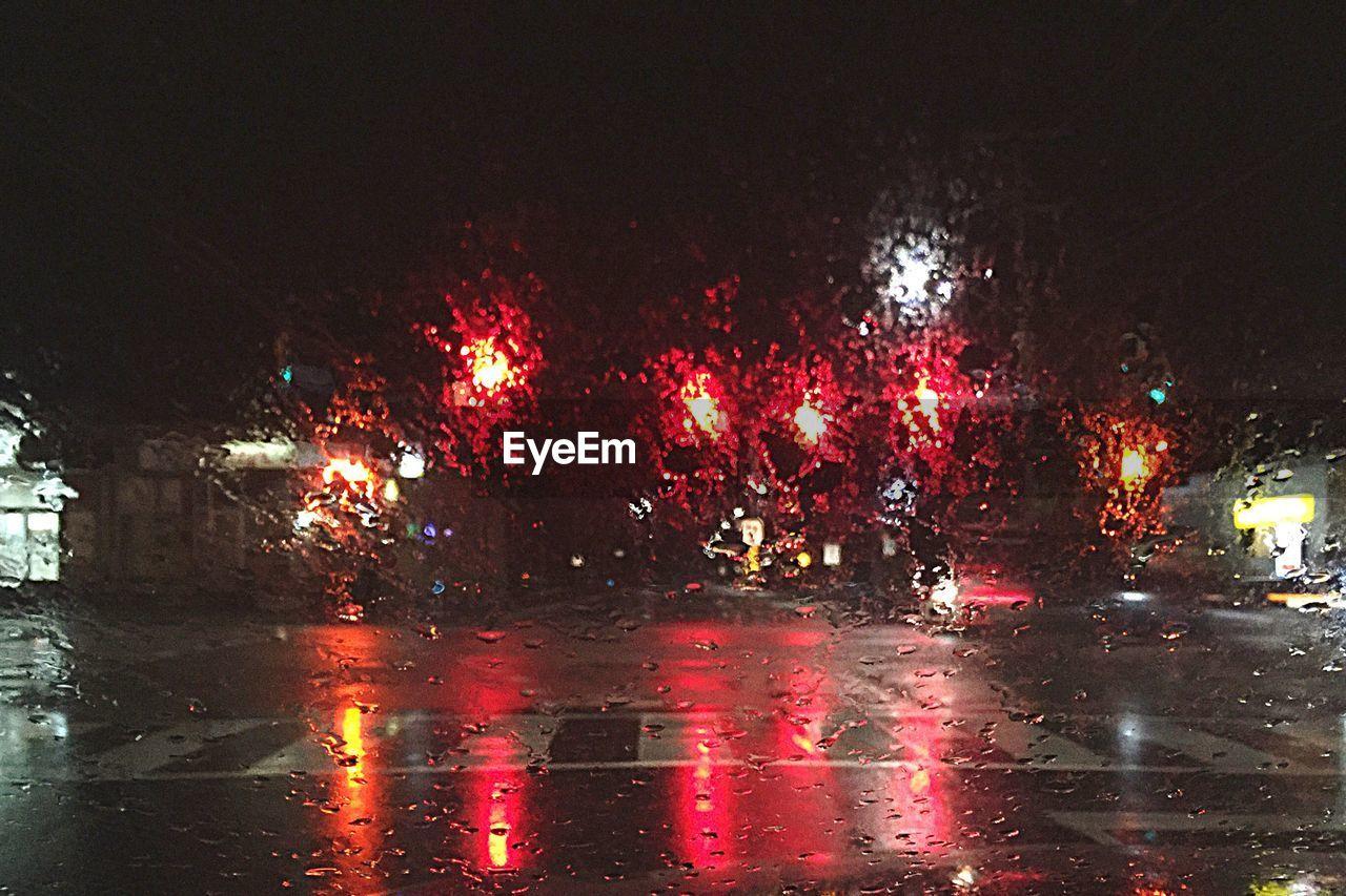 night, car, illuminated, wet, land vehicle, no people, road, outdoors, water