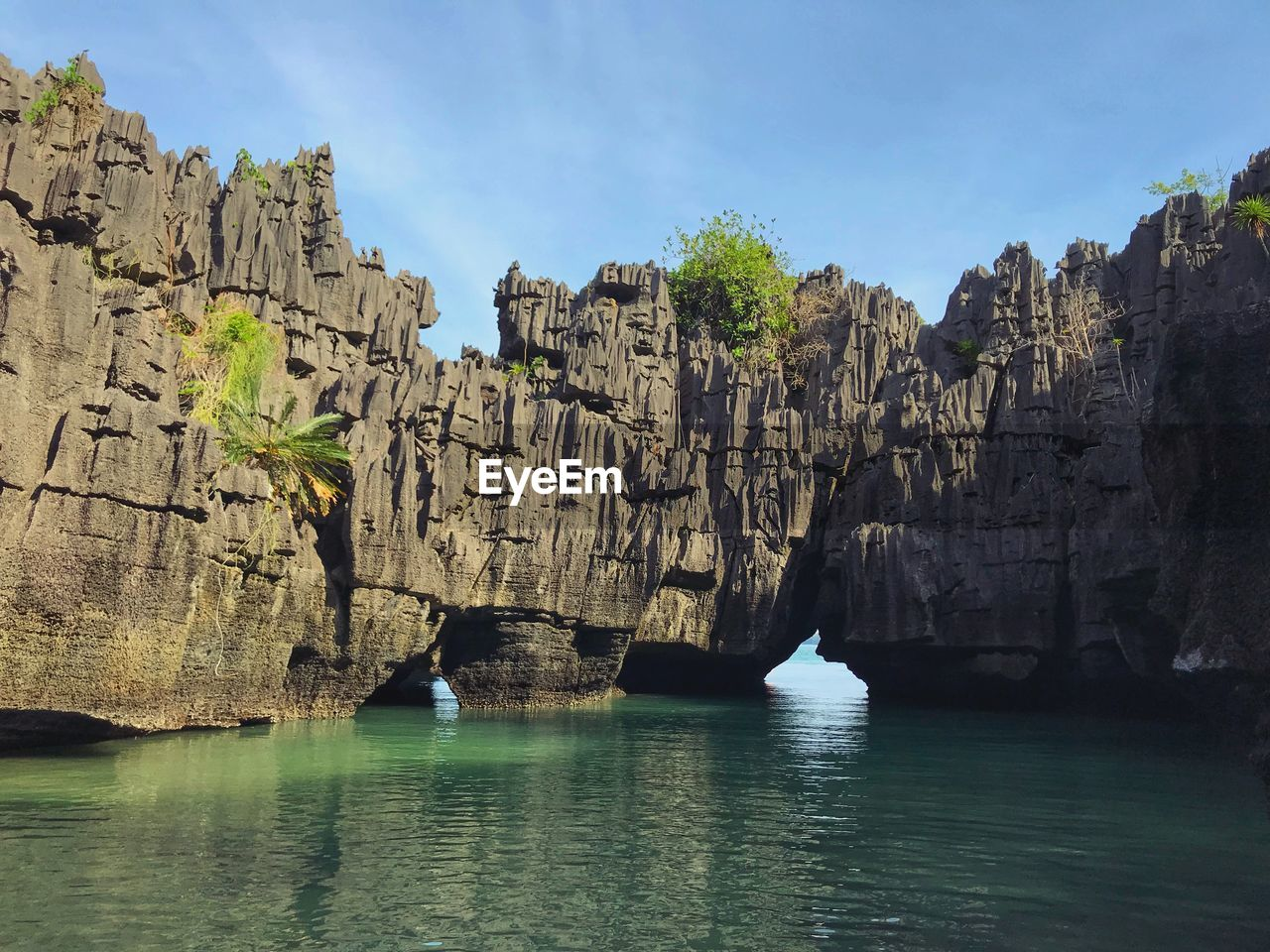 rock formation, rock - object, cliff, nature, water, sea, waterfront, scenics, tranquility, day, no people, tranquil scene, sky, physical geography, beauty in nature, outdoors, travel destinations, scenery, mountain