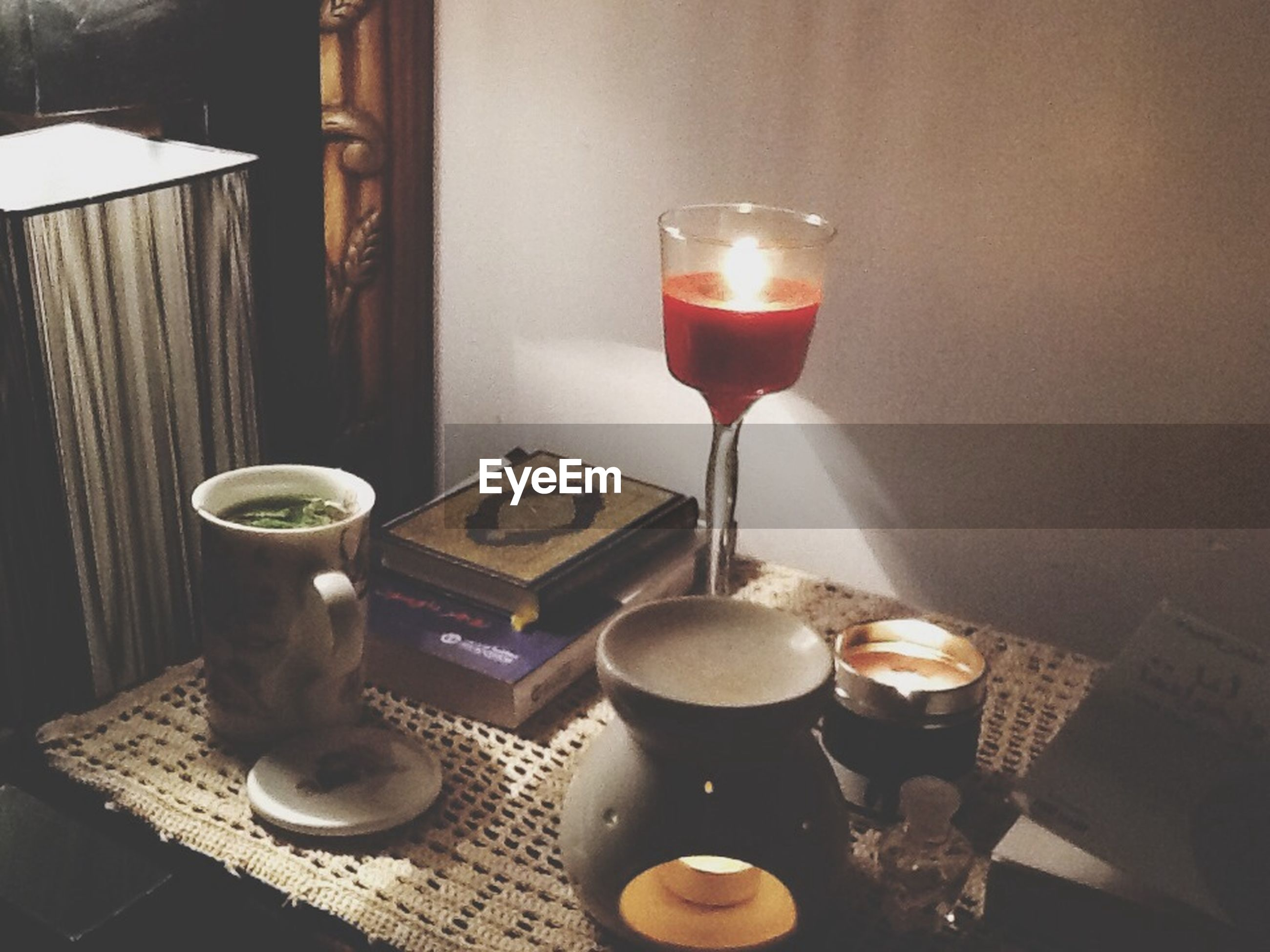 indoors, food and drink, table, drink, refreshment, freshness, still life, candle, drinking glass, wineglass, coffee - drink, burning, close-up, coffee cup, wine, heat - temperature, flame, alcohol, restaurant, illuminated