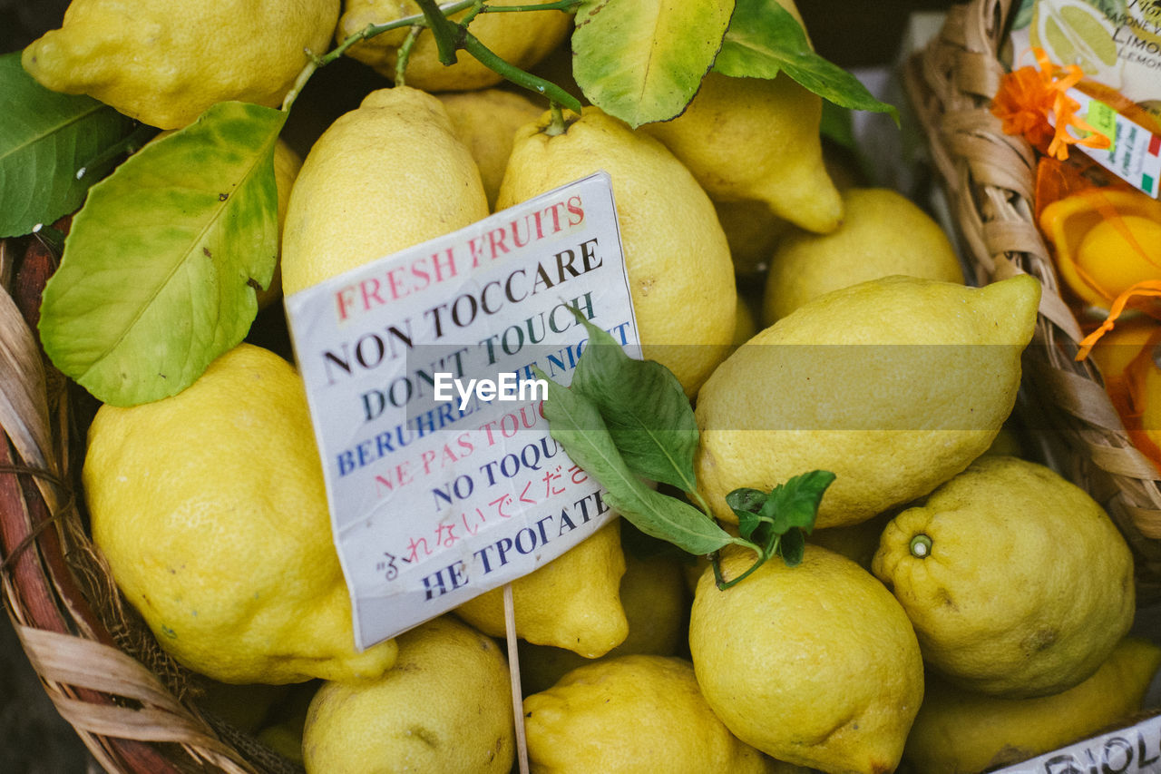 healthy eating, fruit, food, food and drink, market, wellbeing, communication, freshness, text, for sale, retail, price tag, yellow, no people, close-up, market stall, western script, large group of objects, number, day, sale, retail display, ripe