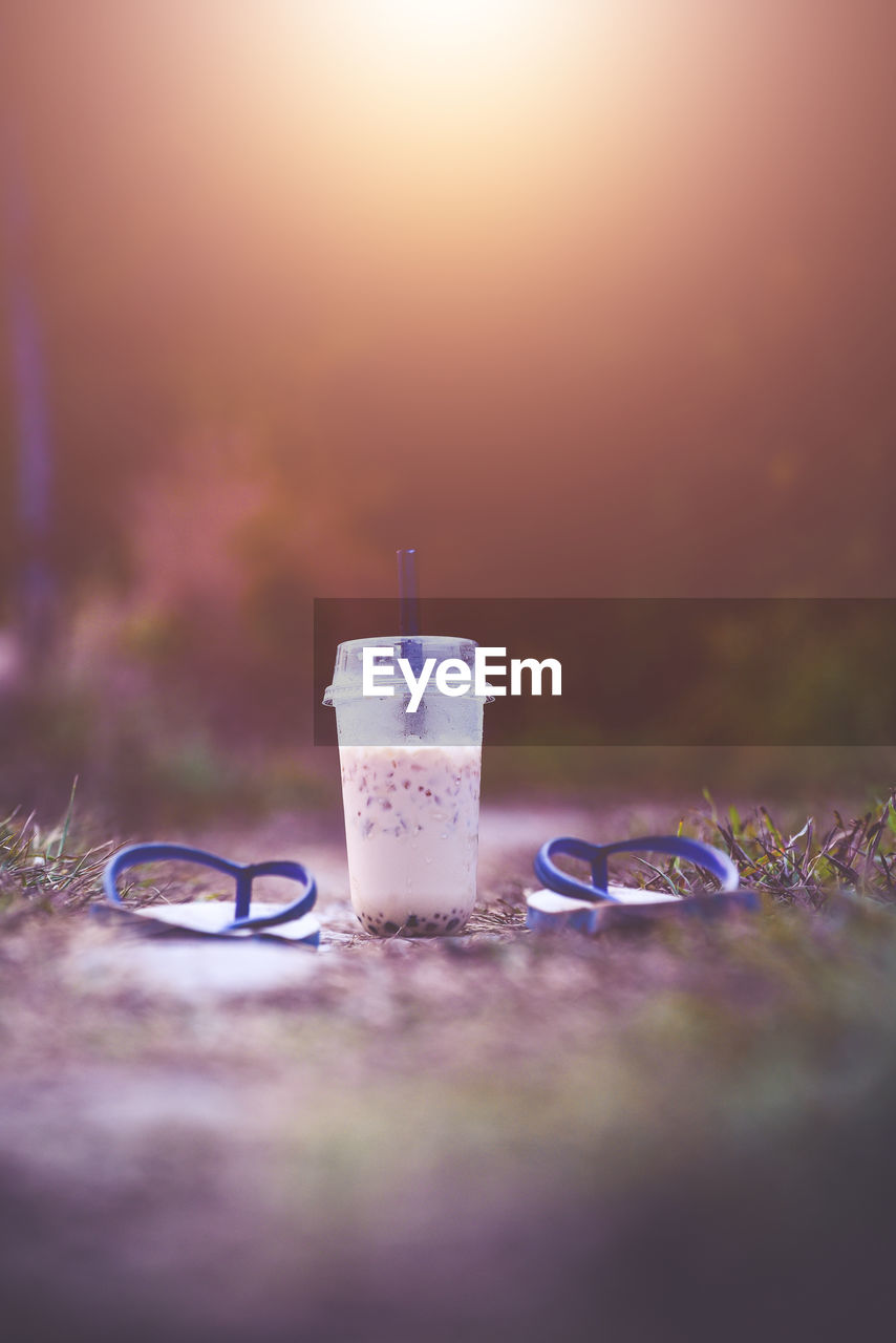 drink, refreshment, selective focus, food and drink, glass, straw, drinking straw, drinking glass, household equipment, table, freshness, no people, still life, milk, nature, close-up, food, outdoors, surface level
