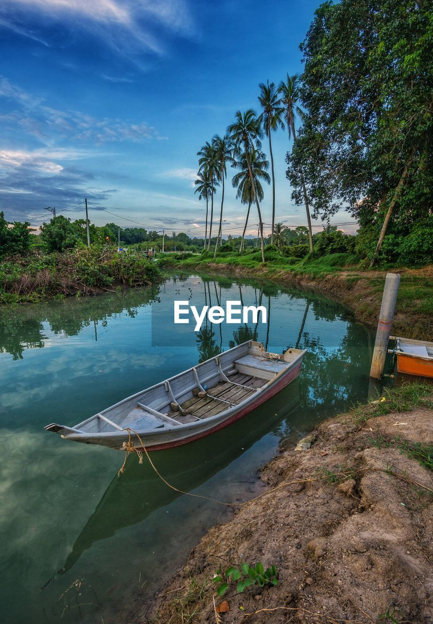 nautical vessel, water, mode of transportation, moored, tree, transportation, sky, plant, nature, tranquility, cloud - sky, tranquil scene, scenics - nature, beauty in nature, no people, day, beach, tropical climate, land, outdoors, rowboat, sailboat