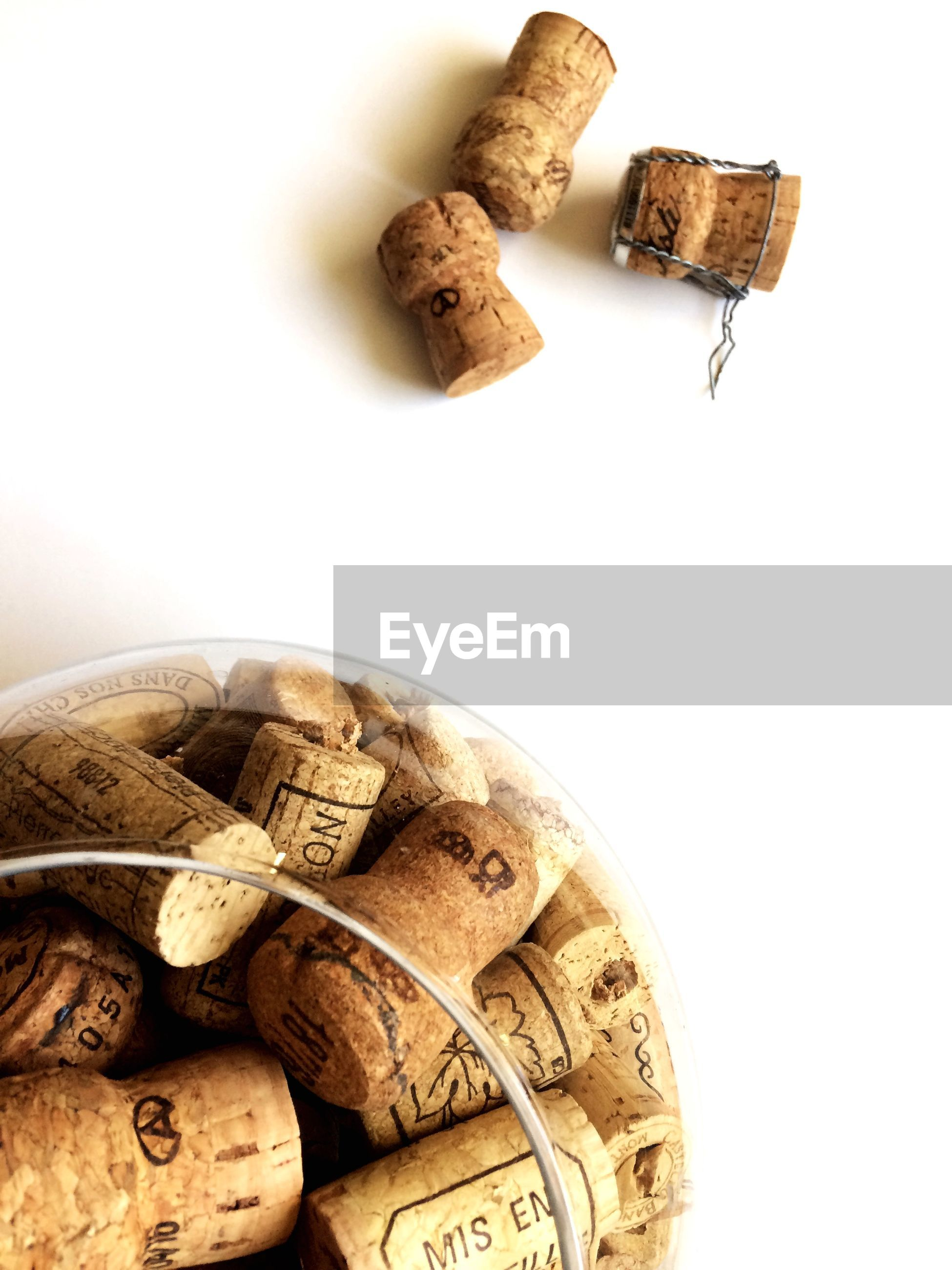 High angle view of corks in container on white background