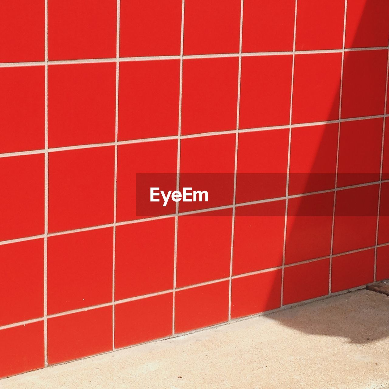 Red tiled wall at street