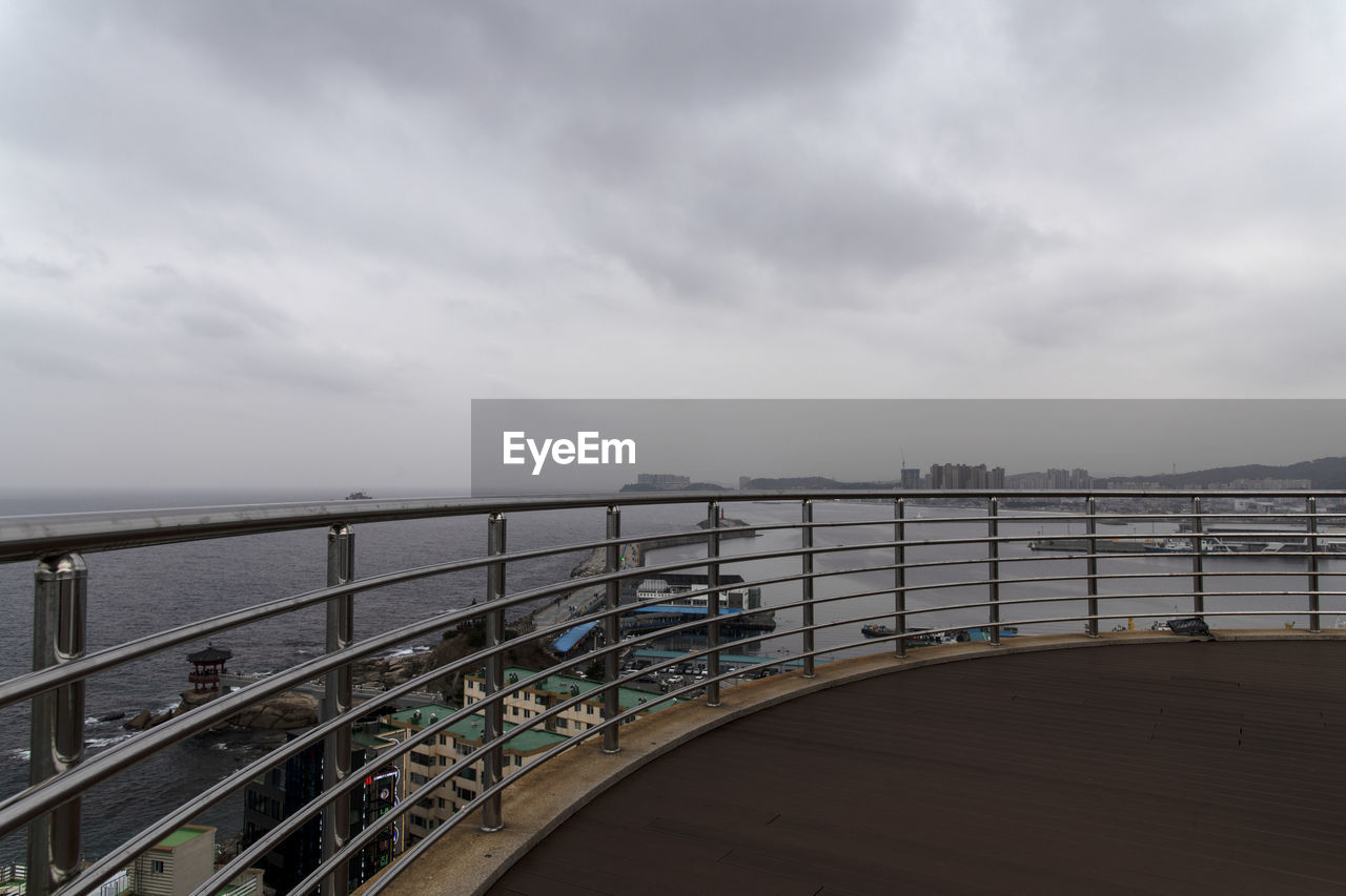 sky, cloud - sky, railing, water, nature, sea, no people, built structure, architecture, day, horizon, beauty in nature, tranquility, scenics - nature, transportation, connection, horizon over water, tranquil scene, outdoors