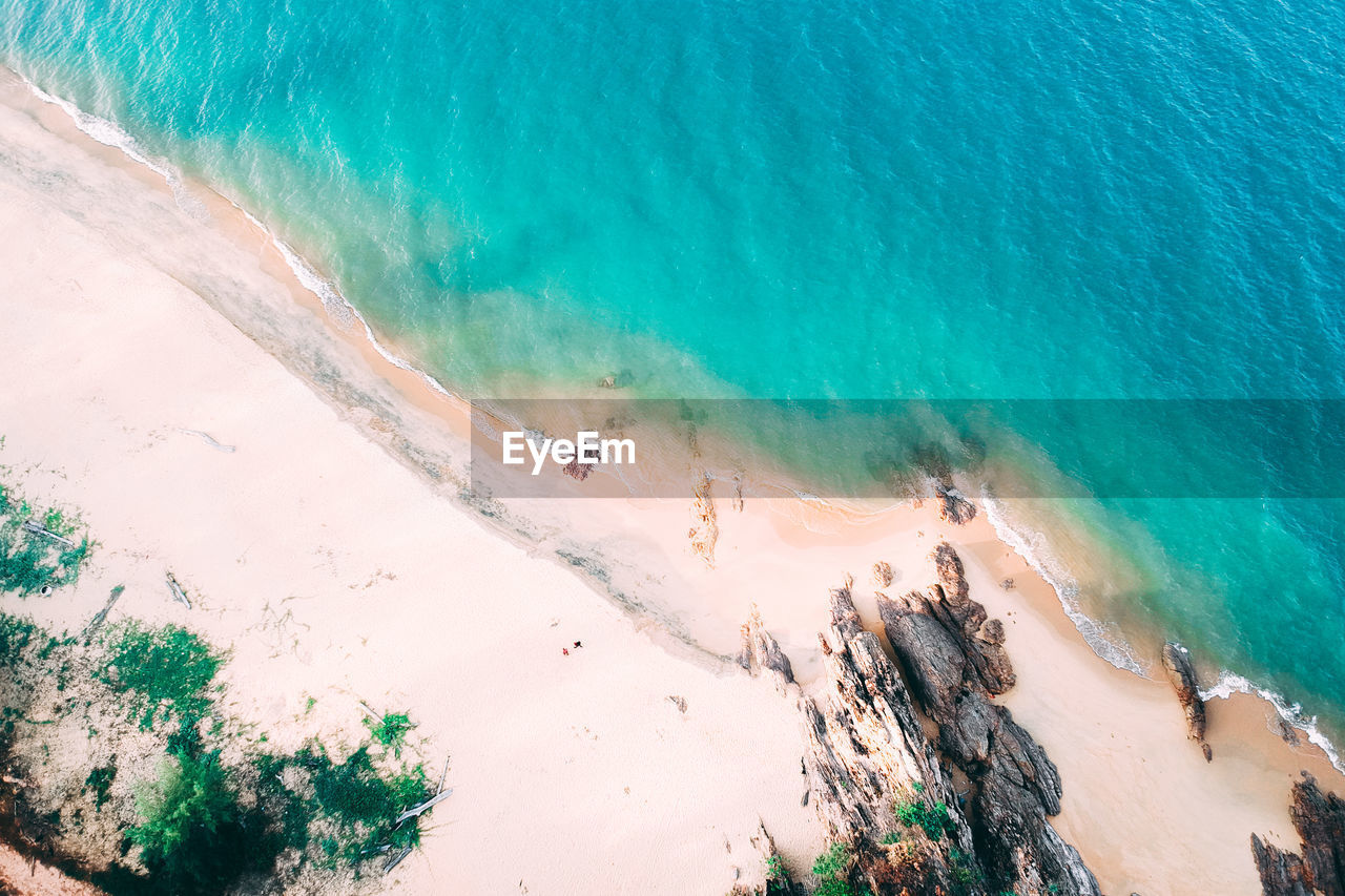 land, water, sea, beach, beauty in nature, scenics - nature, high angle view, nature, turquoise colored, day, sand, tranquility, travel destinations, tranquil scene, idyllic, outdoors, sunlight, no people, hot spring