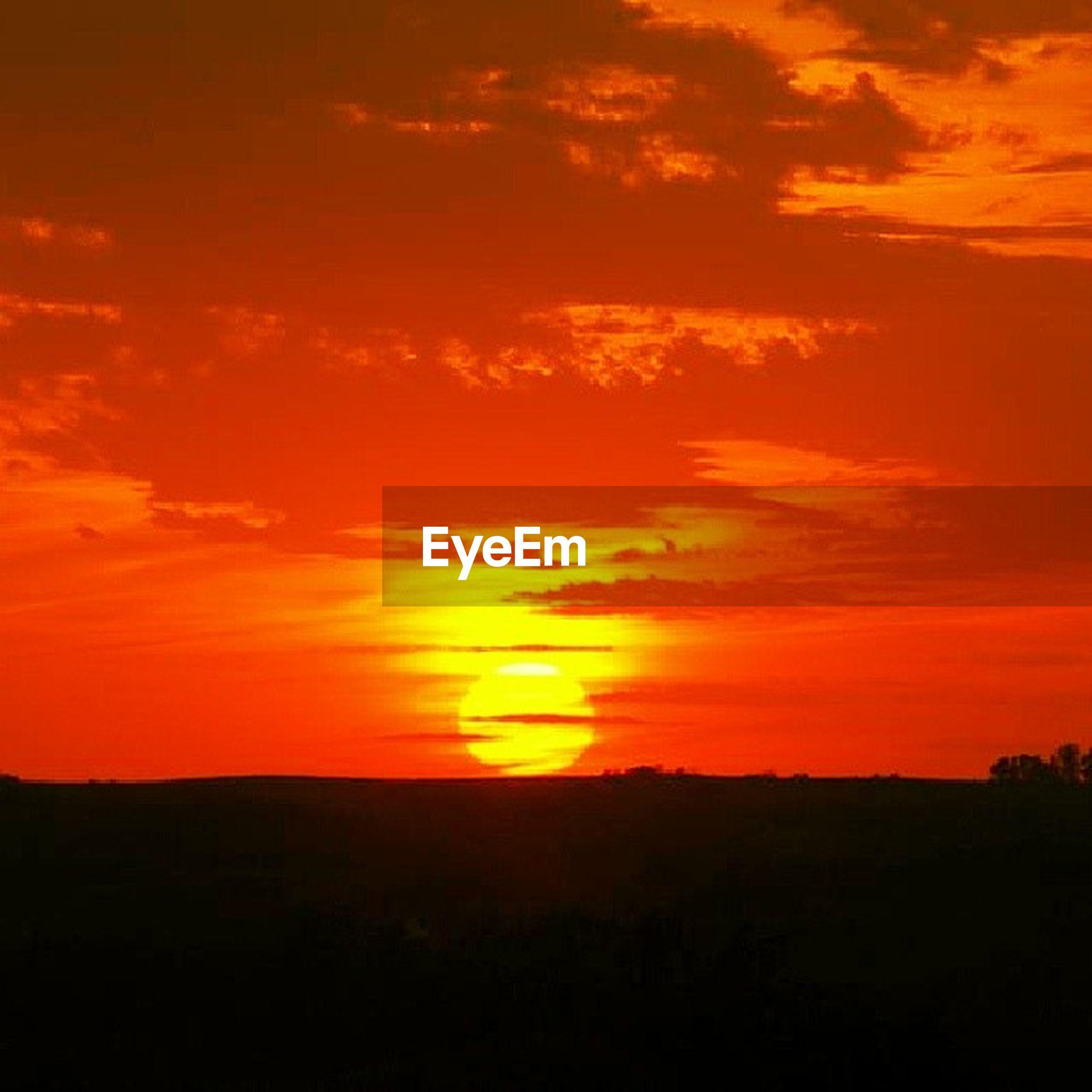 sunset, orange color, scenics, silhouette, tranquil scene, beauty in nature, tranquility, sky, idyllic, sun, nature, landscape, dramatic sky, cloud - sky, mountain, majestic, cloud, outdoors, sunlight, non-urban scene