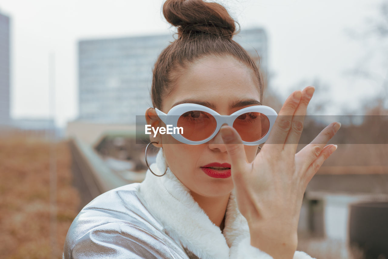headshot, real people, one person, focus on foreground, portrait, lifestyles, glasses, front view, leisure activity, young adult, young women, women, sunglasses, day, adult, fashion, hairstyle, beauty, beautiful woman