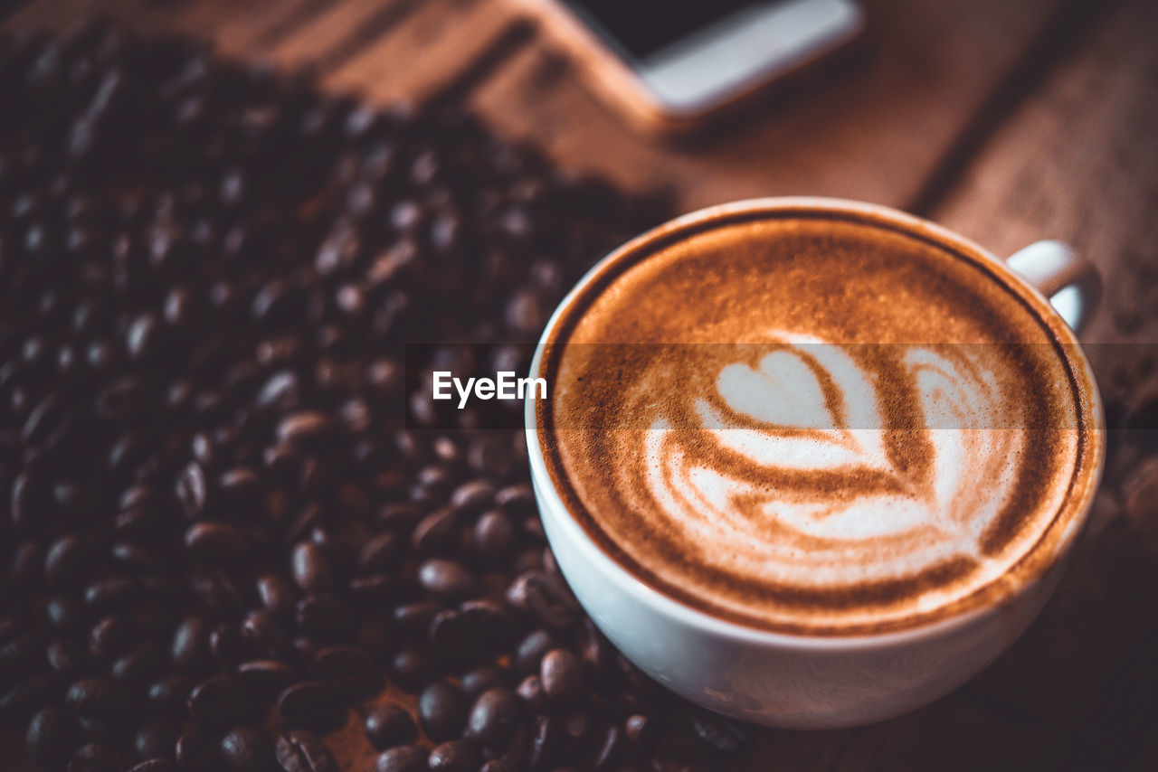 coffee, coffee - drink, drink, coffee cup, food and drink, refreshment, cup, still life, frothy drink, mug, cappuccino, hot drink, froth art, close-up, creativity, freshness, indoors, table, no people, high angle view, latte, crockery, caffeine, non-alcoholic beverage