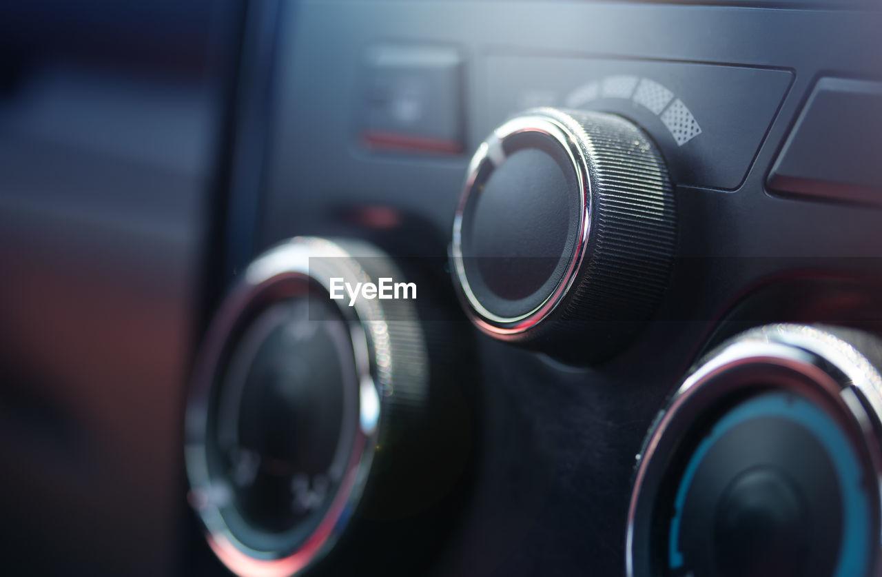 CLOSE-UP OF MACHINE PART IN CAR