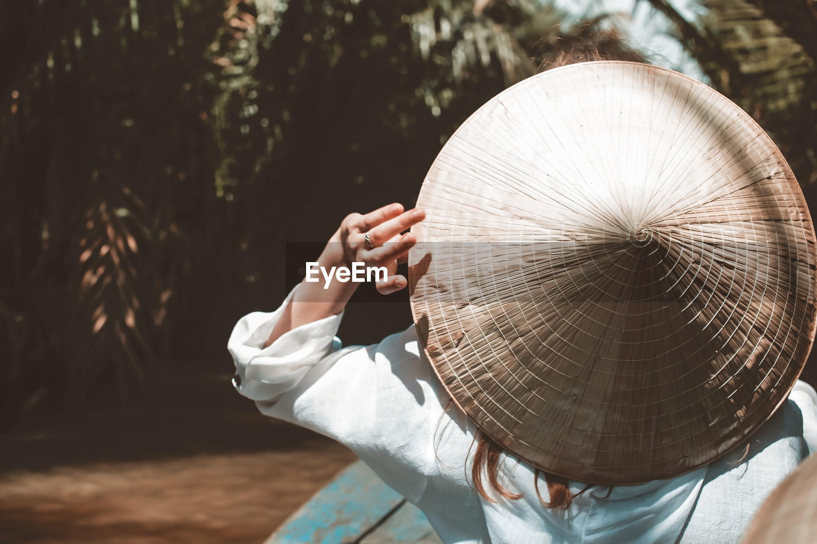 Woman wearing asian hat