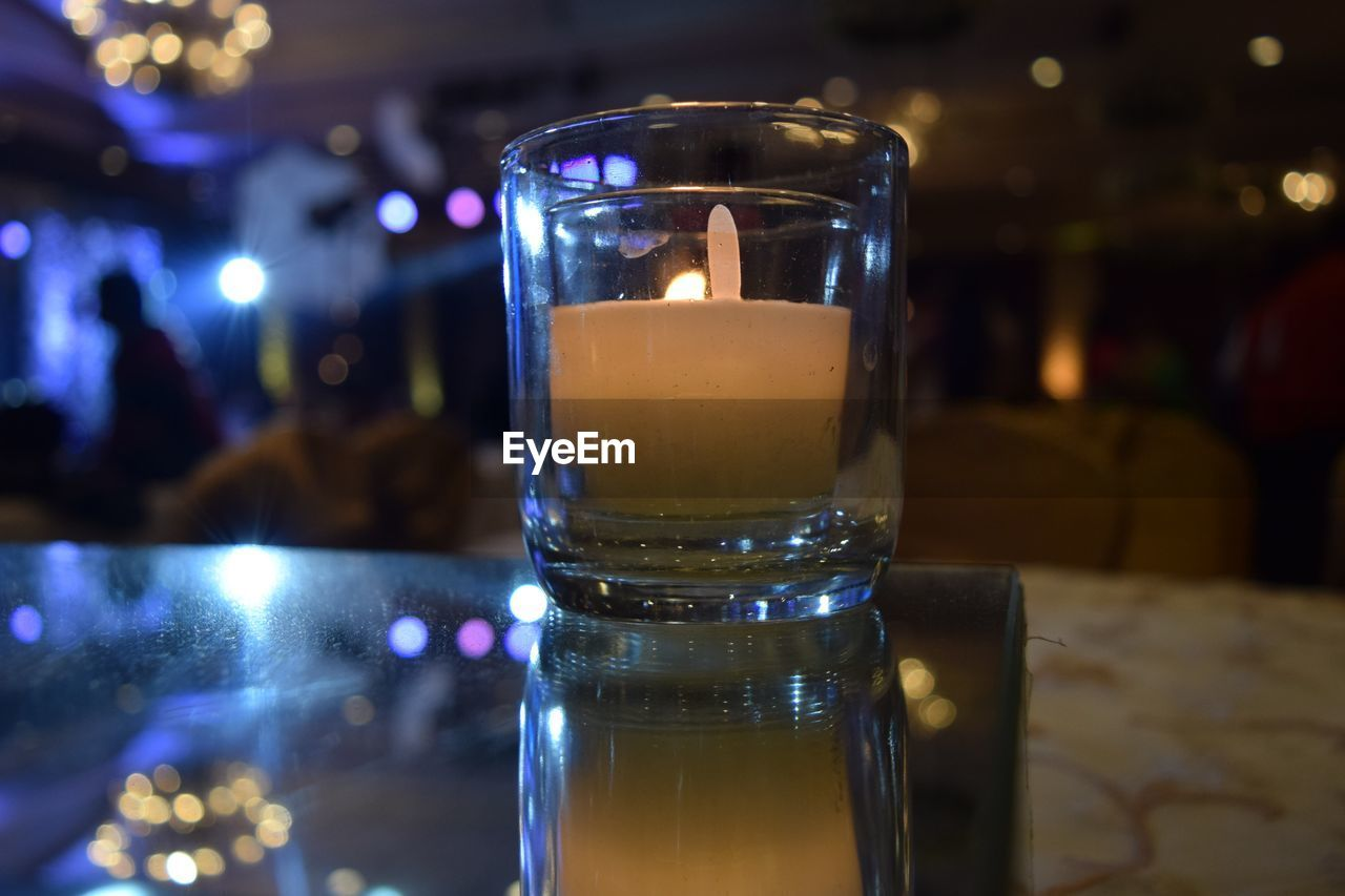 Close-Up Of Tea Light Candle On Table At Restaurant