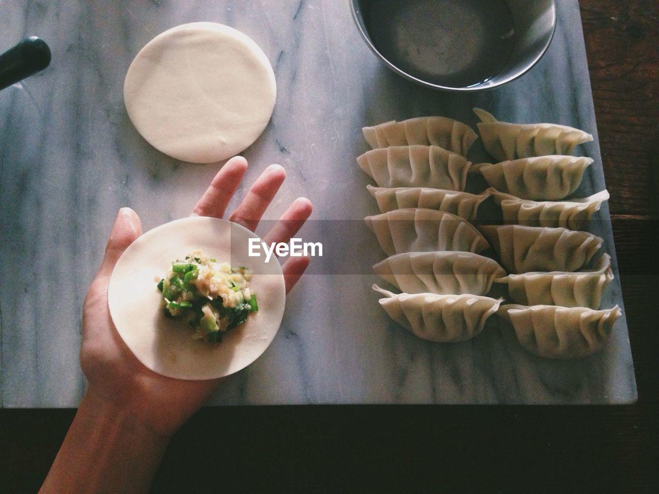 Cropped Image Of Man Preparing Dumplings At Home