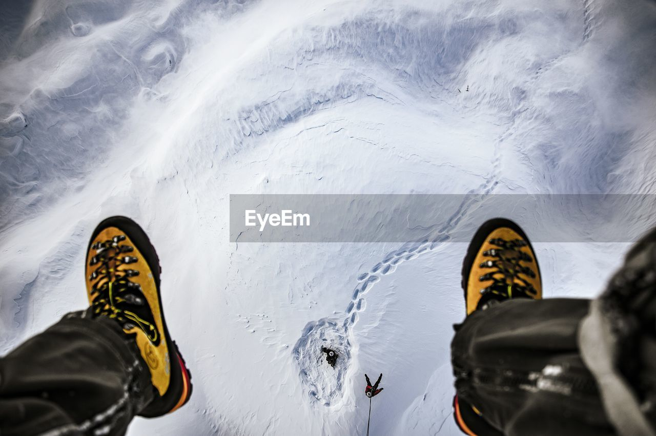 Low Section Of Man Sitting In Ski Lift