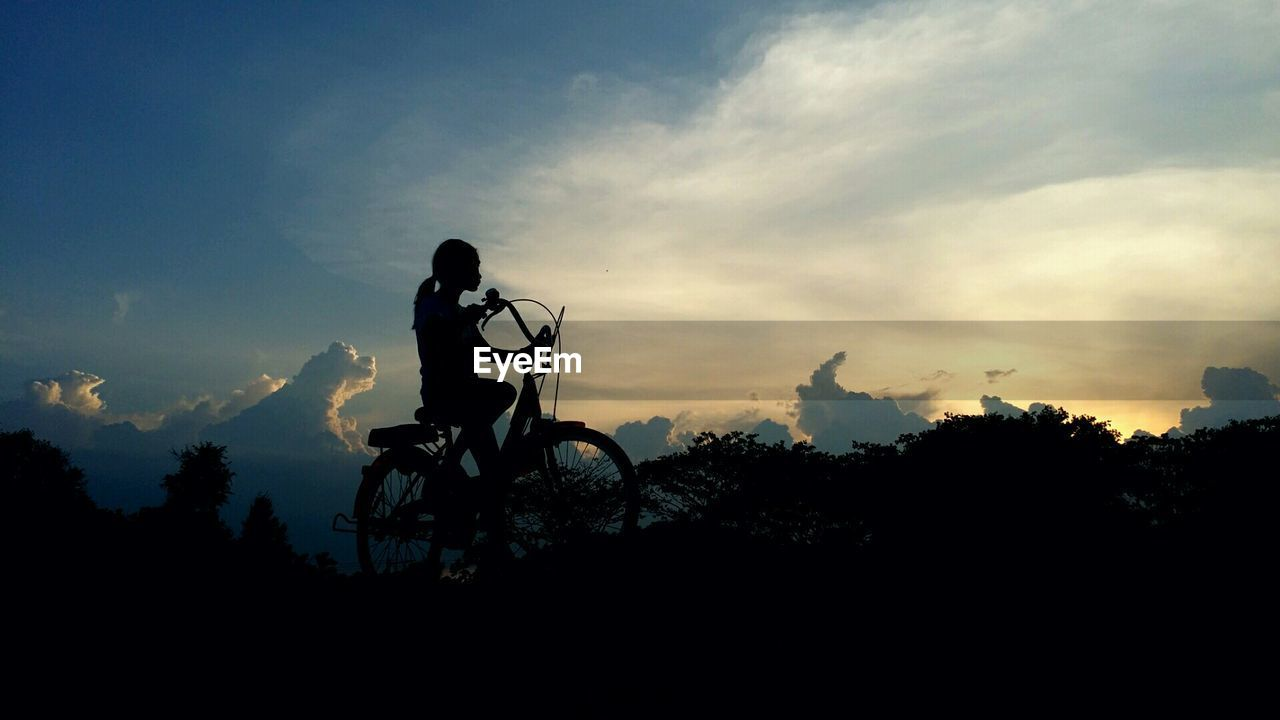 silhouette, sunset, real people, sky, transportation, men, riding, land vehicle, leisure activity, one person, mode of transport, bicycle, cloud - sky, outdoors, nature, motorcycle, lifestyles, tree, beauty in nature, biker, day, motocross, people