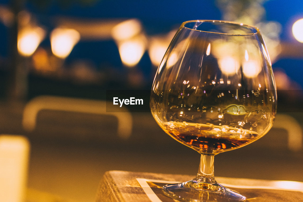focus on foreground, table, close-up, wine, wineglass, no people, refreshment, drink, food and drink, alcohol, indoors, freshness, illuminated, nature, fragility, day