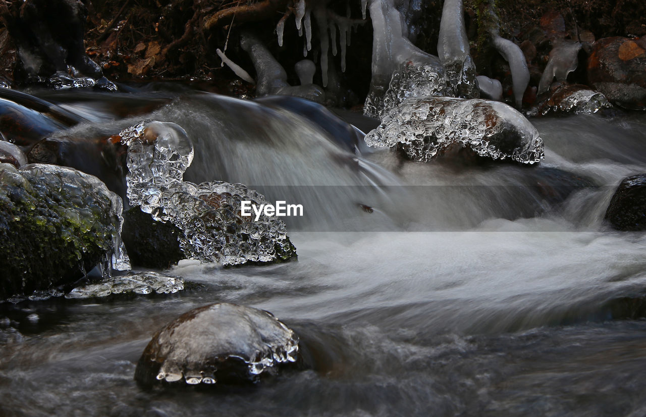 water, motion, long exposure, flowing water, waterfall, scenics - nature, rock, beauty in nature, blurred motion, waterfront, nature, no people, flowing, rock - object, splashing, solid, aquatic sport, river, day, outdoors, power in nature, stream - flowing water, falling water, running water, purity