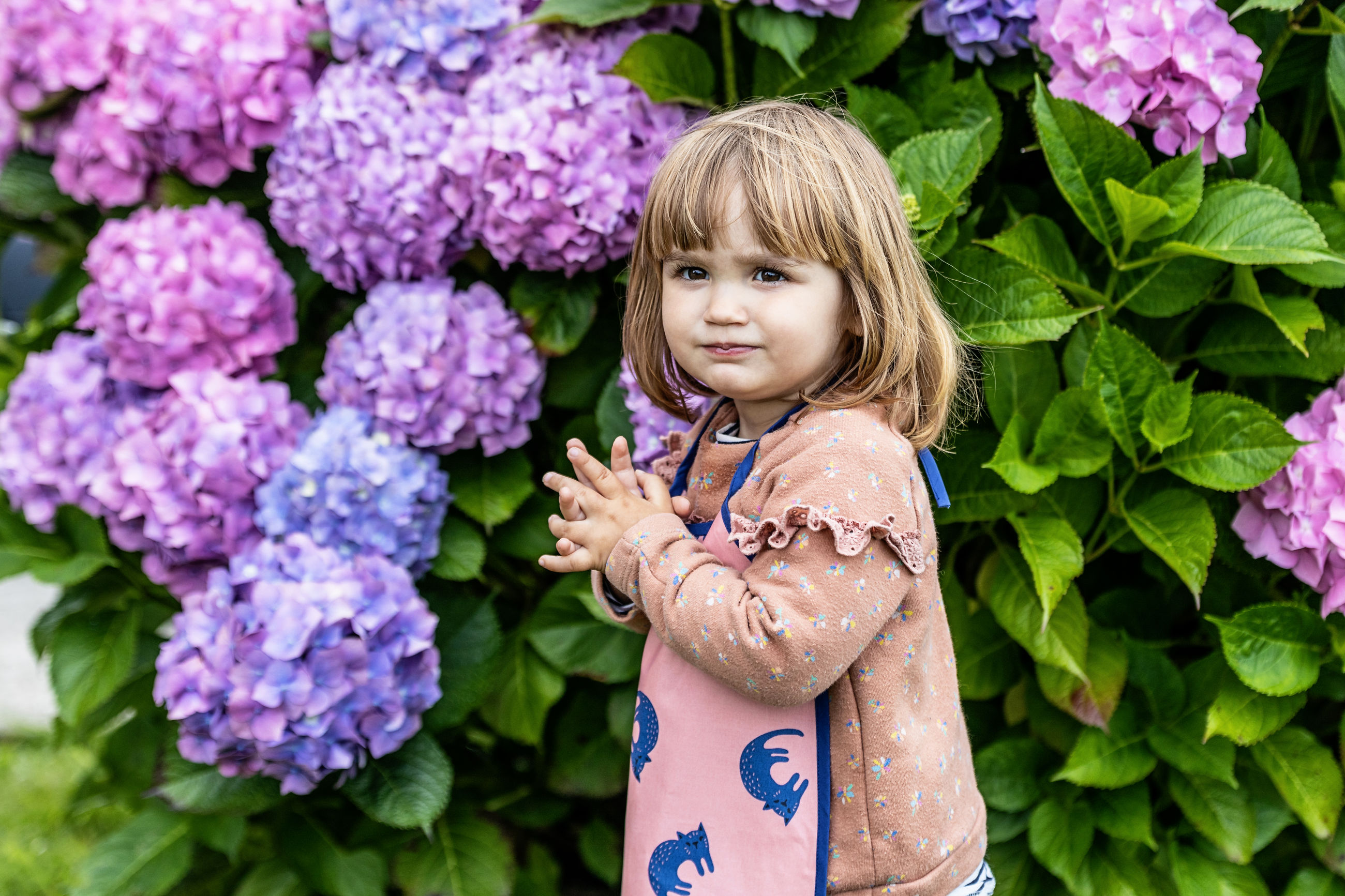 PORTRAIT OF A GIRL WITH PURPLE FLOWER