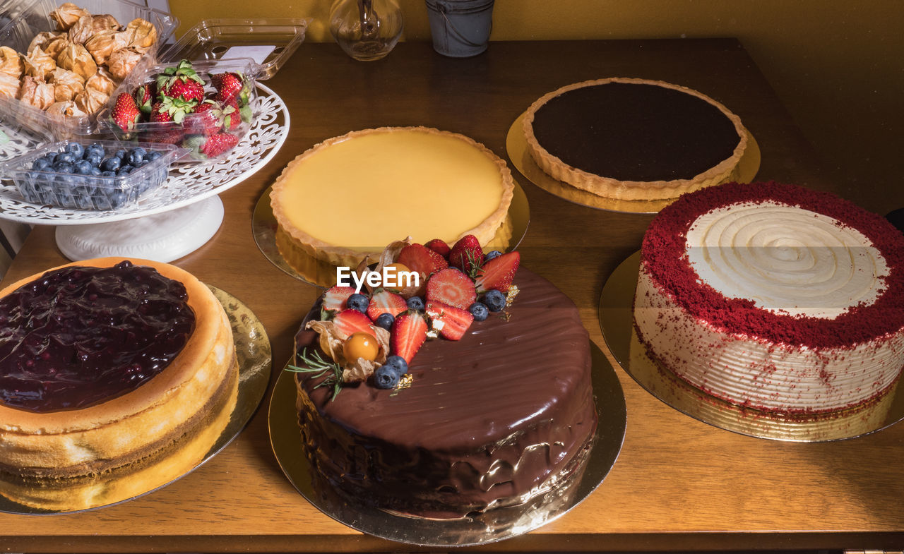 food and drink, food, table, freshness, still life, sweet food, high angle view, indoors, sweet, indulgence, no people, dessert, choice, ready-to-eat, variation, temptation, baked, cake, unhealthy eating, container