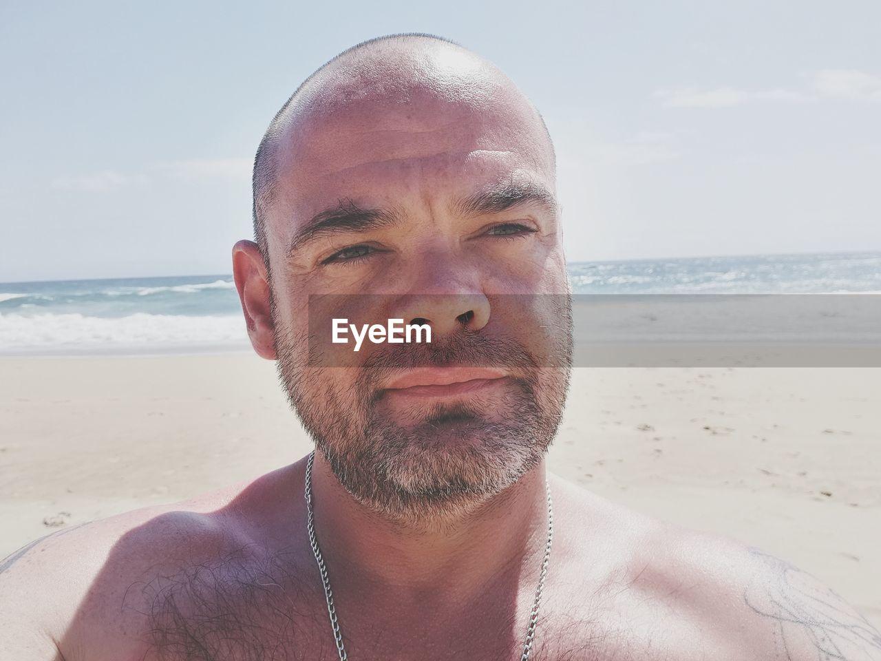 Close-Up Of Shirtless Man At Beach
