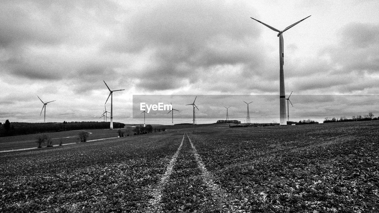 wind turbine, wind power, environmental conservation, alternative energy, fuel and power generation, windmill, renewable energy, industrial windmill, rural scene, technology, field, sky, outdoors, day, no people, the way forward, cloud - sky, nature, landscape, traditional windmill