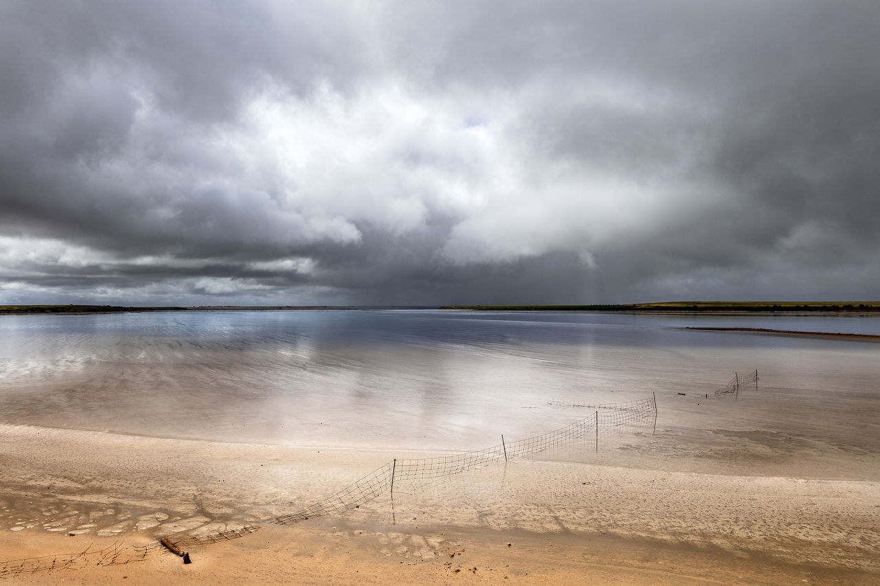 cloud - sky, sky, beauty in nature, water, scenics - nature, tranquil scene, beach, land, tranquility, sea, nature, overcast, no people, storm, non-urban scene, sand, storm cloud, horizon over water, outdoors, salt flat