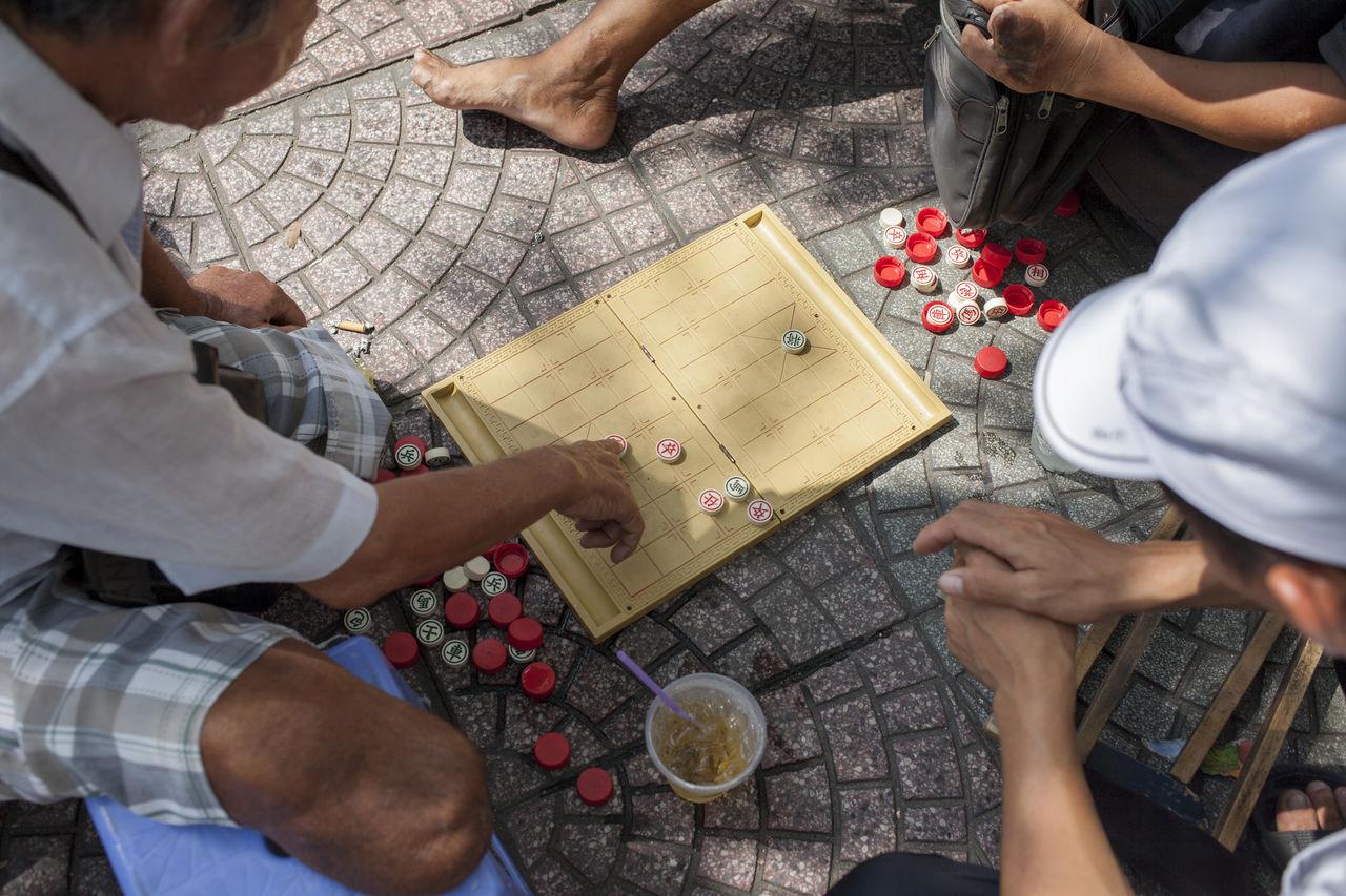 Cropped Image Of People Gambling On Street