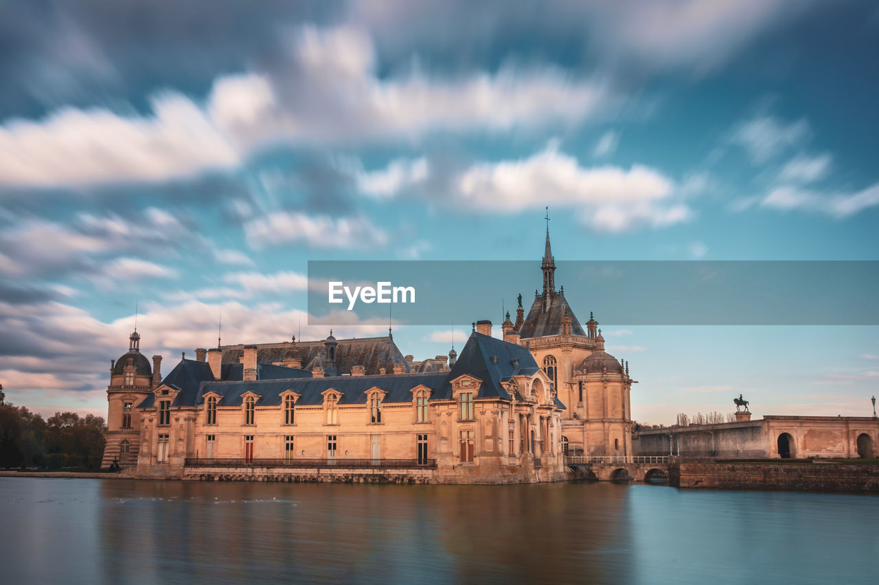 built structure, architecture, cloud - sky, sky, building exterior, water, travel destinations, building, waterfront, history, the past, nature, city, tower, river, travel, no people, tourism, religion, outdoors, spire