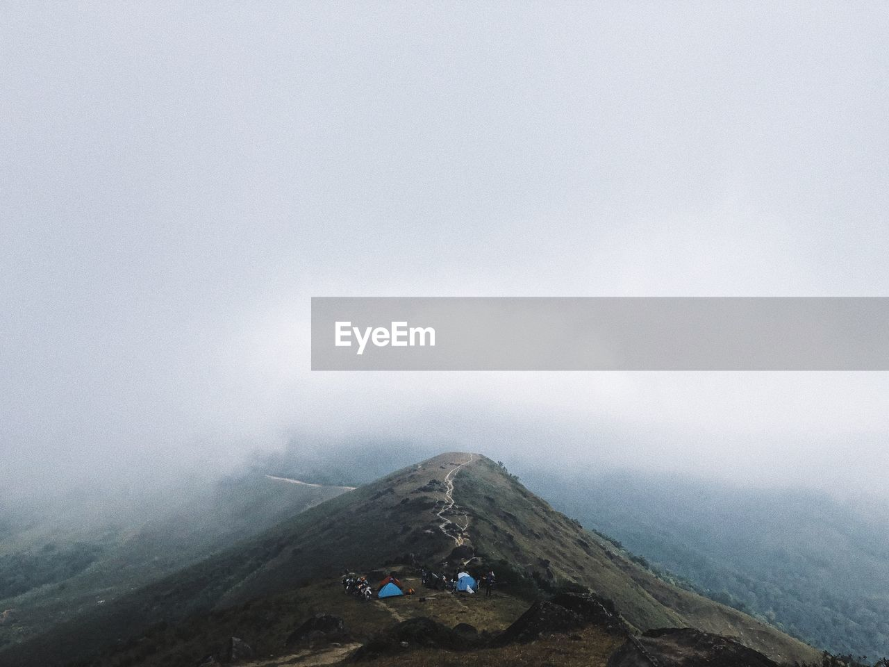 fog, mountain, scenics - nature, sky, tranquil scene, beauty in nature, environment, tranquility, nature, non-urban scene, day, leisure activity, landscape, copy space, idyllic, cold temperature, real people, lifestyles, tourism, outdoors
