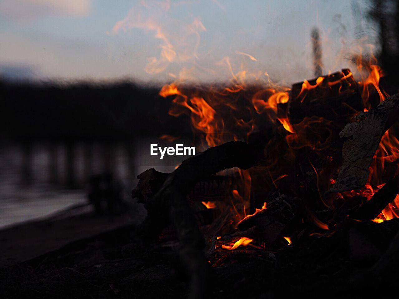 Close-Up Of Burning Bonfire During Sunset