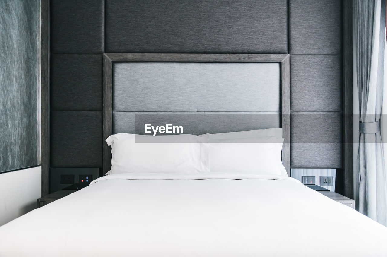 White Pillows On Bed At Home