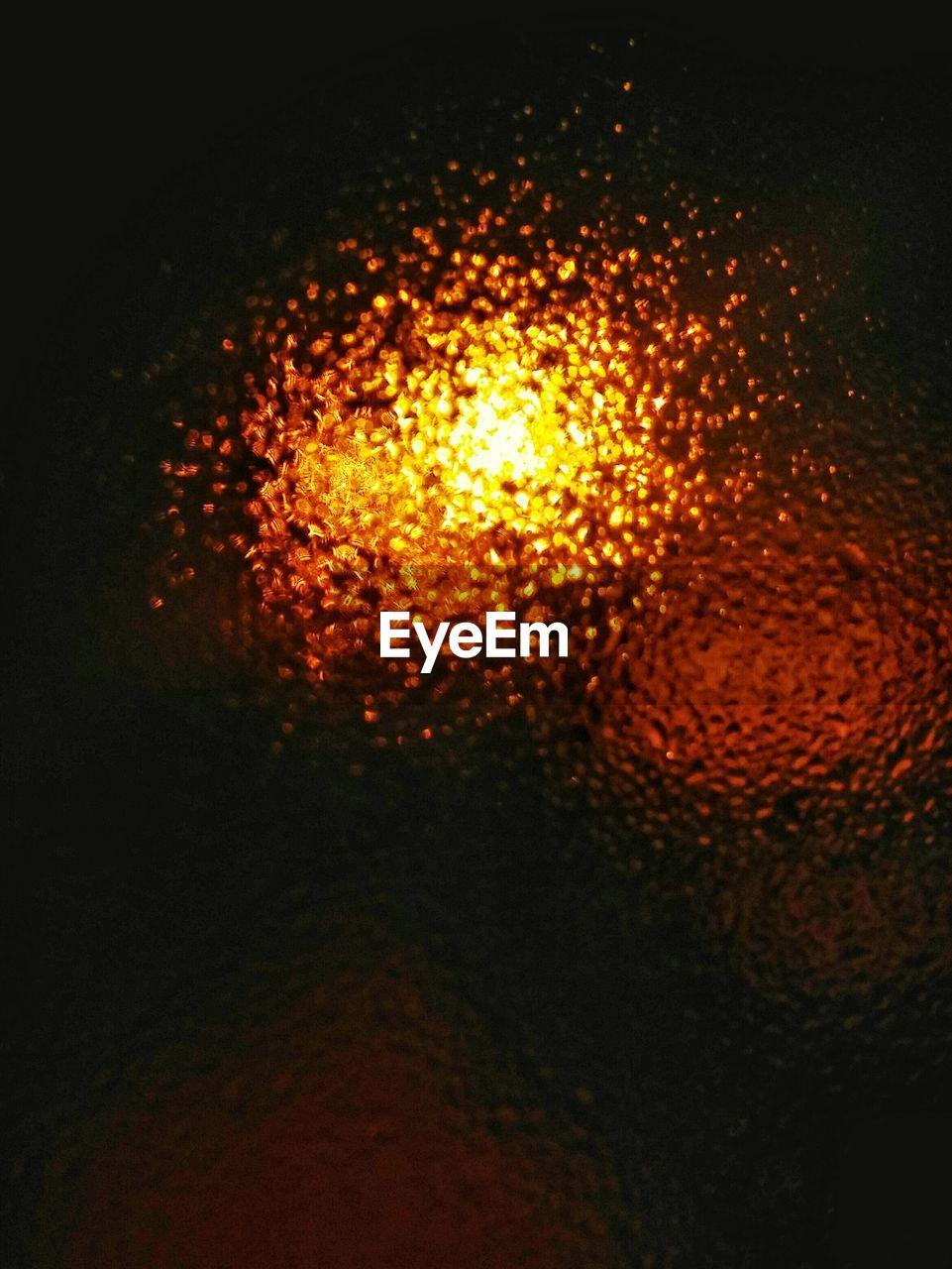 night, no people, close-up, heat - temperature, illuminated, indoors, black background