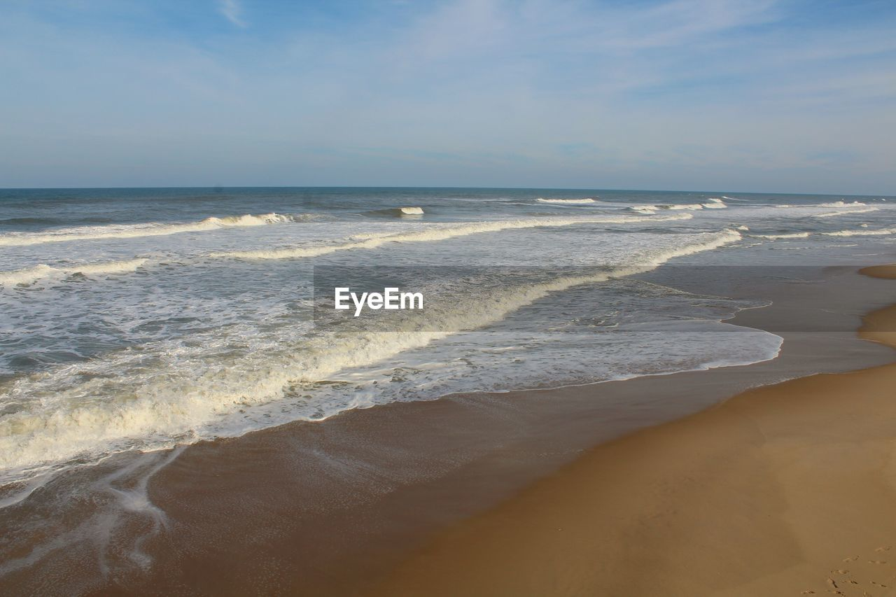 sea, water, beach, land, beauty in nature, horizon over water, scenics - nature, motion, wave, horizon, aquatic sport, sky, sport, sand, surfing, tranquility, tranquil scene, idyllic, nature, outdoors